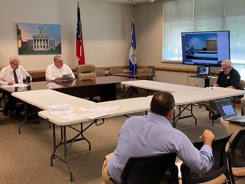 Members of the Cartersville-Bartow Metropolitan Planning Organization gather for Wednesday afternoon's public meeting.