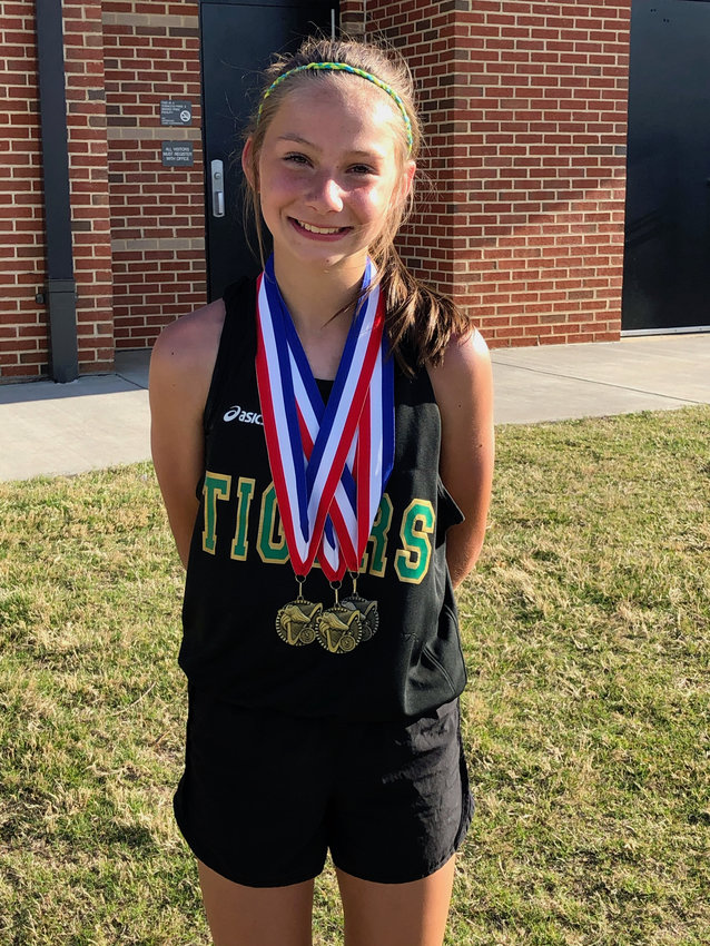 Adairsville Middle's Samantha Gough poses with three medals earned during the Bartow-Gordon Middle School Athletic Association region meet on May 1 at Weinman Stadium in Cartersville. Gough won the 1600-meter run, as well as the 800. She also helped the Tigers' 4x400 team finish runner-up. Her time in the 1600 of 5 minutes, 28.59 seconds proved to be the fastest in the state this year by a sixth-grader.