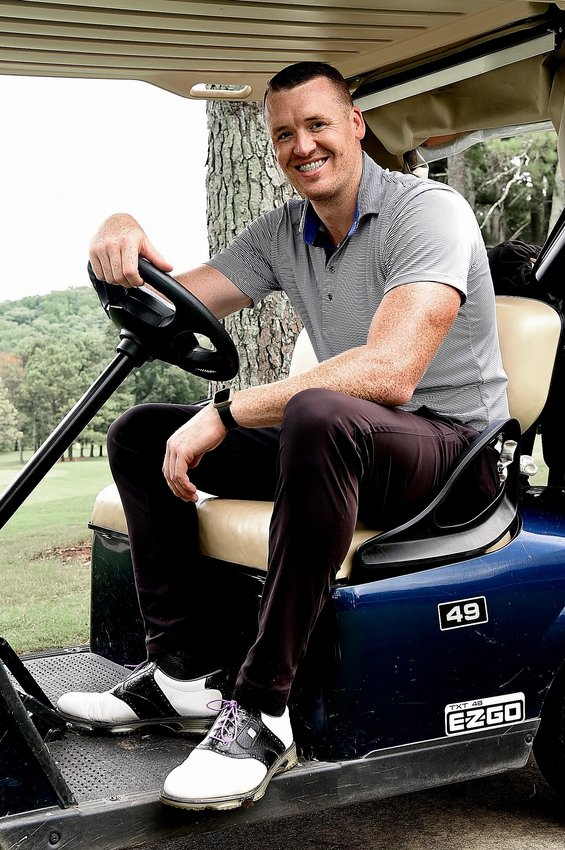 Cartersville resident R.B. Clyburn poses for a photo on a golf cart last week at Cartersville Country Club. Clyburn recently qualified for the U.S. Amateur set to be played Aug. 9-15 primarily at Oakmont Country Club in Pennsylvania.
