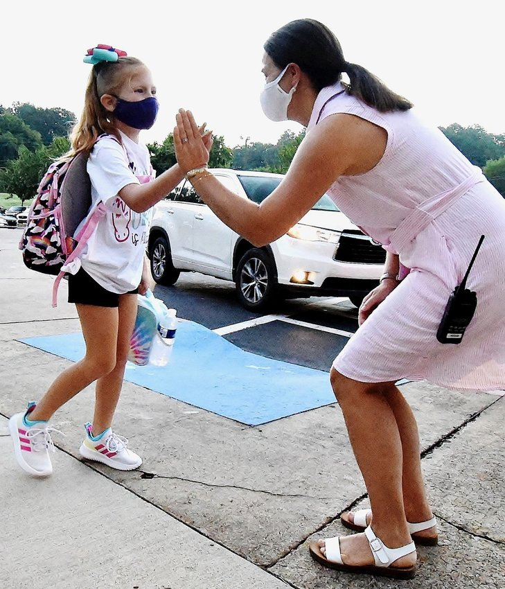 Cartersville Primary Assistant Principal Katie Vaughan greets a student with a high-five on Cartersville City Schools' first day of school last year.