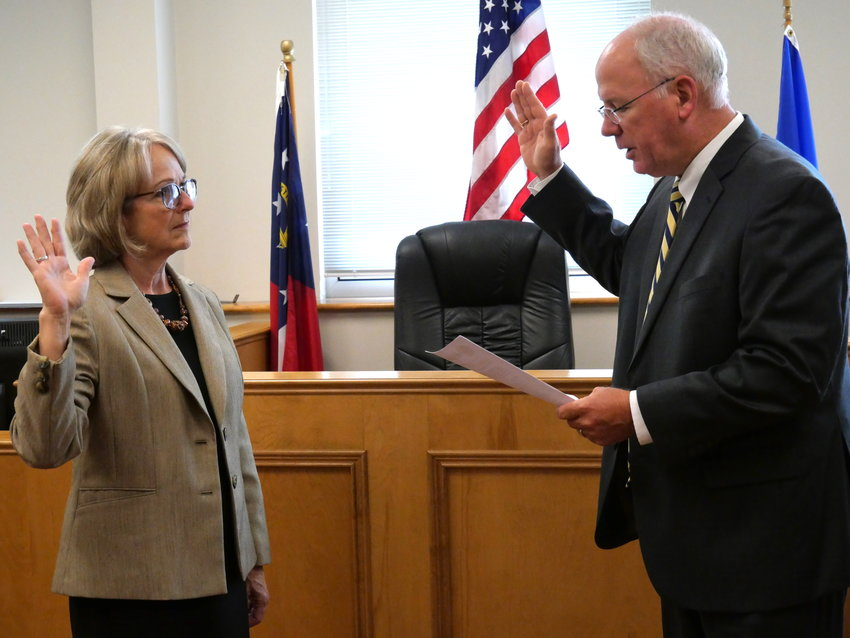 Peggy Brown is sworn in as the newest Bartow County Board of Elections and Voter Registration member by Bartow County Probate Court Judge Barry Greene on Monday afternoon.