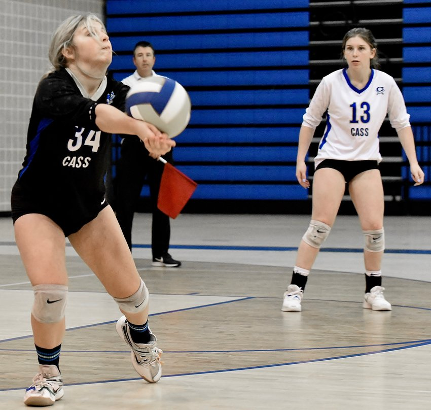 Cass libero Sherry Wells looks to pass the ball, as teammate Bailey Elrod looks on, during a Region 7-5A match against Calhoun Thursday at home.