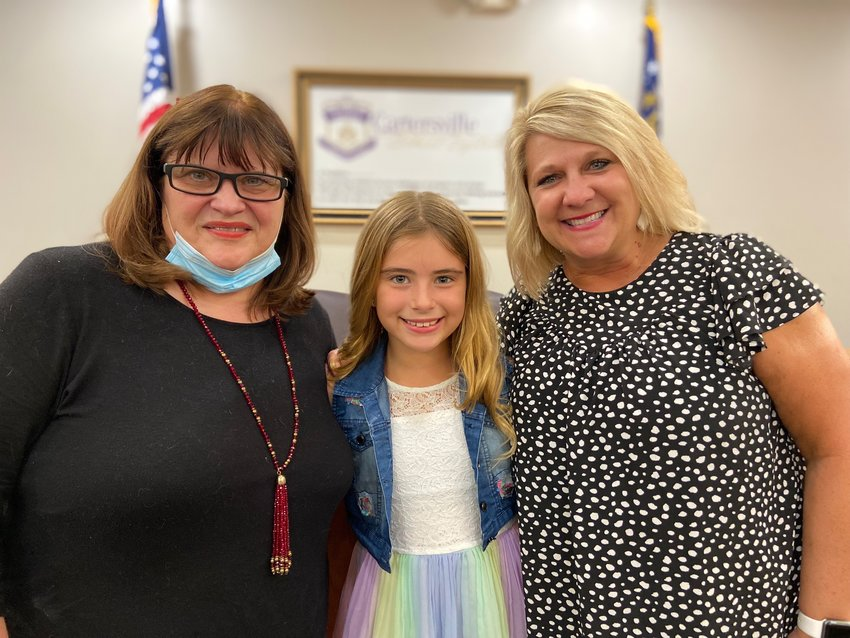Cartersville Primary second-grader Katalin Ongay-Lopez was honored Monday night by school board President Kelley Dial, left, and Principal Gina Bishop for being named the first Linda Benton Student of the Month for CPS.