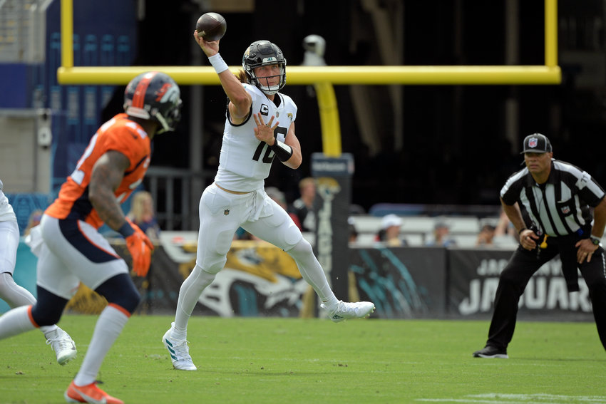 Jacksonville Jaguars quarterback Trevor Lawrence, right, throws a pass against the Denver Broncos during the first half of a game, Sunday in Jacksonville, Florida.