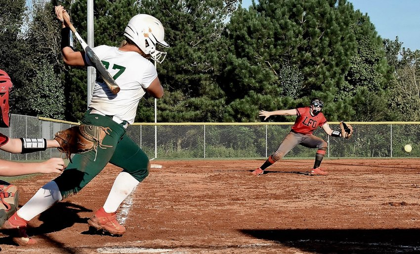 Adairsville's Kelsey Gleason hits a two-run, walk-off single through the infield to lift the Tigers to a 2-1 win over Lakeview-Fort Oglethorpe Tuesday at home.