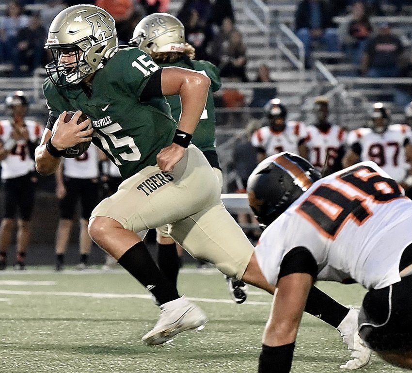 Adairsville sophomore quarterback Jonathan Gough carries the ball during Friday's game at Tiger Stadium against LaFayette.