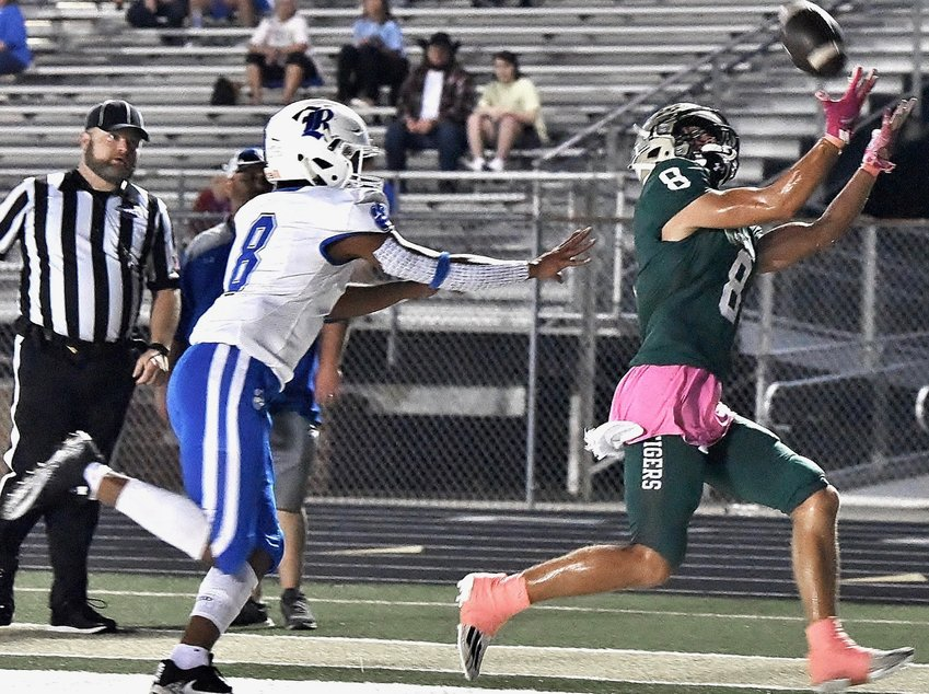 Adairsville's Grayson Belcher reels in a pass from Jonathan Gough for a touchdown during Friday night's game against Ringgold in Tiger Stadium.