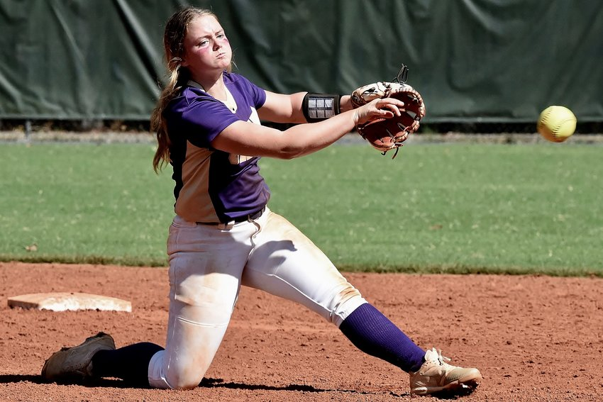 Cartersville junior Ava Perkins throws a Blessed Trinity runner out at first base during a Region 7-5A doubleheader Saturday in Roswell.