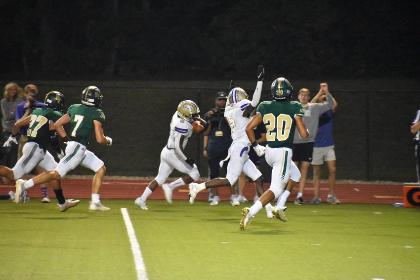 Cartersville senior Amari White heads towards the end zone, as teammate Jaqualyn Mayhall celebrates the soon-to-be touchdown, during a Region 7-5A matchup against Blessed Trinity Friday in Roswell. White compiled 180 yards from scrimmage, including 148 on the ground, and scored three total touchdowns in a 49-21 victory.