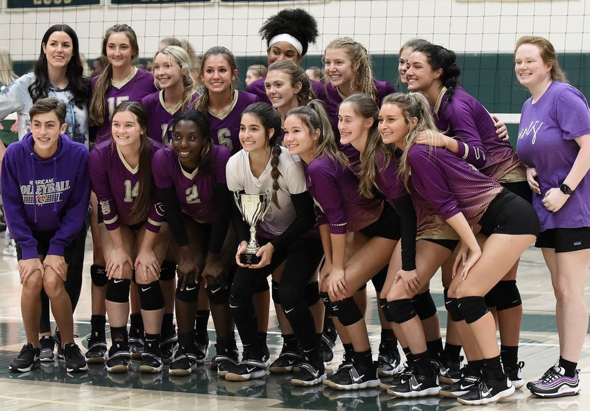 The Cartersville volleyball team poses with the runner-up trophy from the Region 7-5A tournament Saturday at Blessed Trinity.