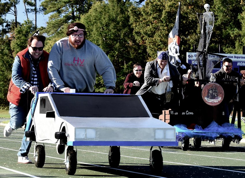 SOS Mattress, left, and Southern Cove run to the finish line at last year's Bed Race & Family Festival.