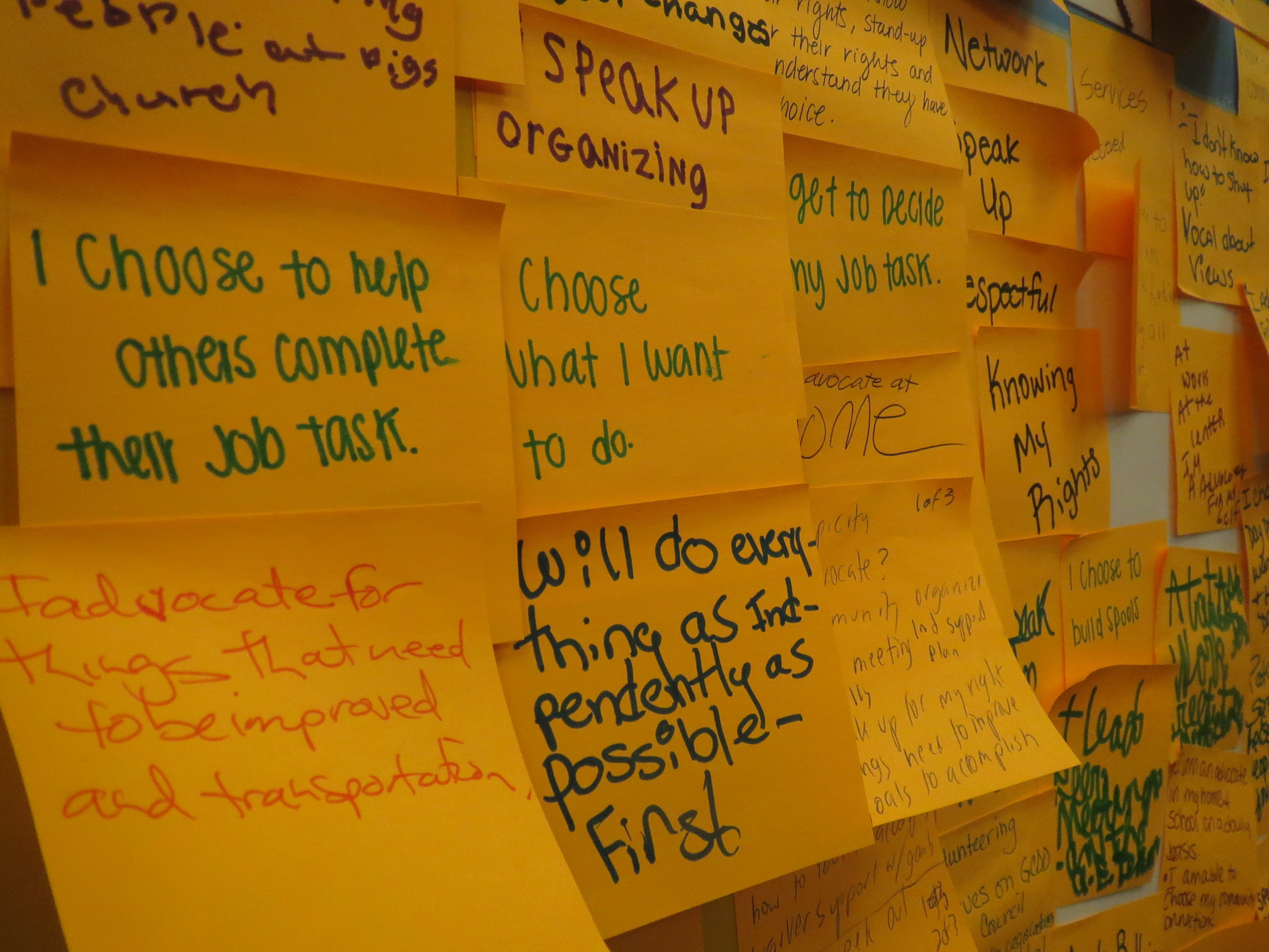 Attendees at Thursday's Sangha Unity Network Self-Advocacy Network Planning Session placed notes on a board outlining their personal goals.
