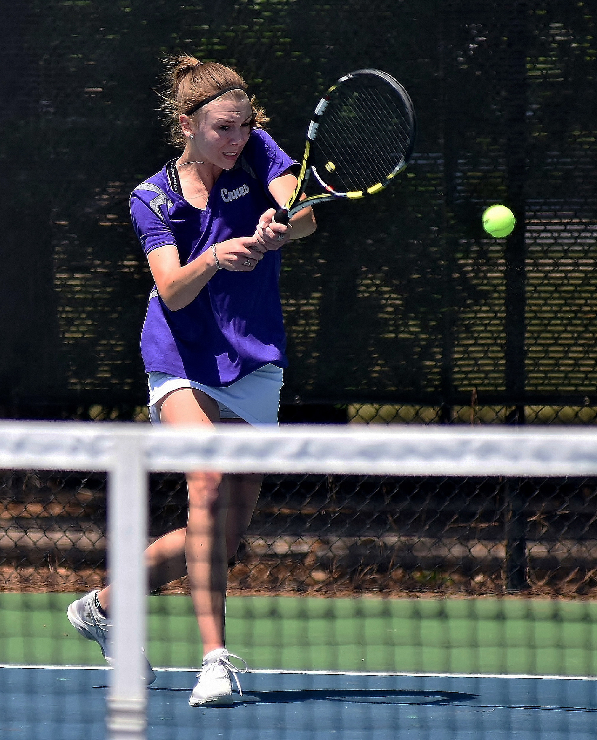 Cartersville senior Emma McCary fires a return during her 6-0, 6-0 win on Line 2 singles in the quarterfinals of the GHSA Class 4A state tournament Friday at Dellinger Park. McCary provided the lone win on the day for the Canes, who fell to Columbus by a 3-1 score.