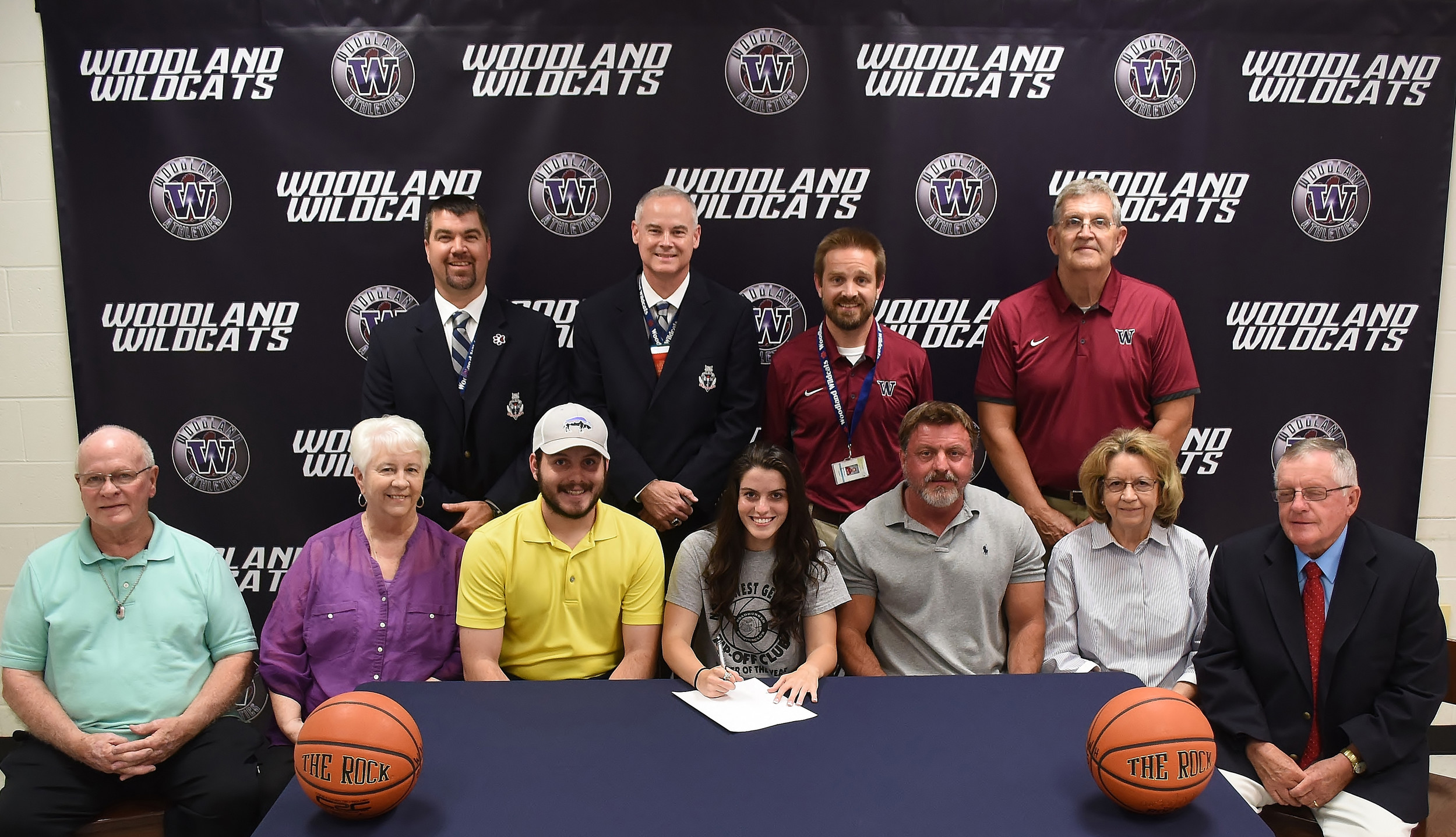 Woodland High senior Whitney Harris, center, signed Friday to play basketball at Toccoa Falls College. On hand for the signing were, front row, from left, Jack Galloway, grandfather; Joyce Galloway, grandmother; Denver Harris, brother; Eric Harris, father; Patsy Harris, grandmother; Tommy Harris, grandfather; back row, John Howard, Woodland athletic director; Dr. Wes Dickey, Woodland principal; Kyle Morgan, Woodland head girls basketball coach; and Steve Dunnington, Woodland assistant girls basketball coach.