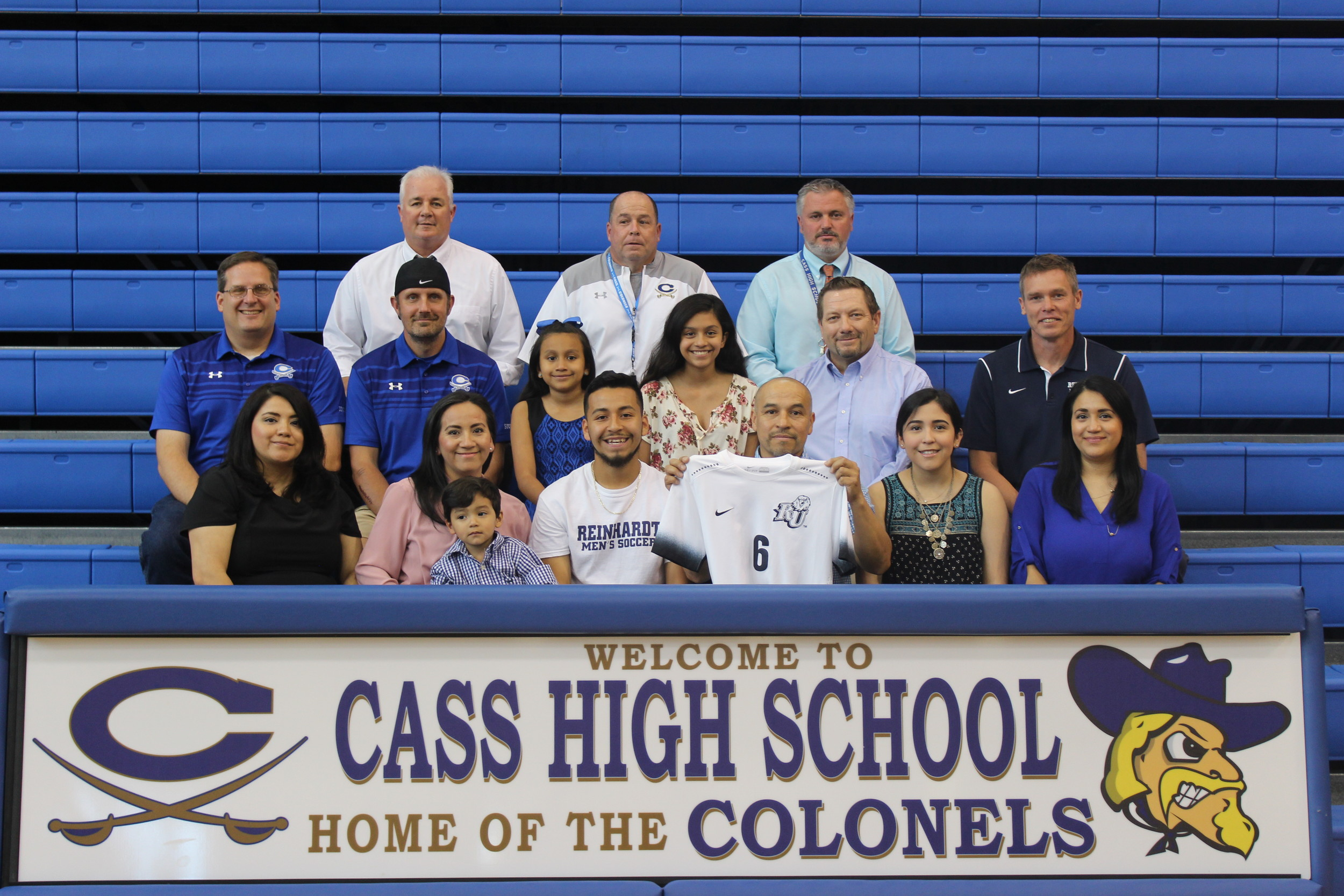 Cass High senior Anthony Robledo, center, signed Wednesday to play soccer at Reinhardt University in Waleska. On hand for the signing were, from left, front row, Nancy Benjume, aunt; Maricela Robledo, mother; Santiago Robledo, brother; Constancio Robledo, father; Stephanie Robledo, sister; Belinda Benjume, aunt; middle row, Dan Armstead, Cass assistant coach; E.J. Kukoly, Cass assistant coach; Shania Hernandez, cousin; Yahaira Hernandez, cousin; Terry Floyd, Cass head coach; Joey Johnson, Reinhardt head men's soccer coach; back row, Nicky Moore, Cass athletic director; Bobby Hughes, Cass head football coach; and Mike Nelson, Cass High principal.