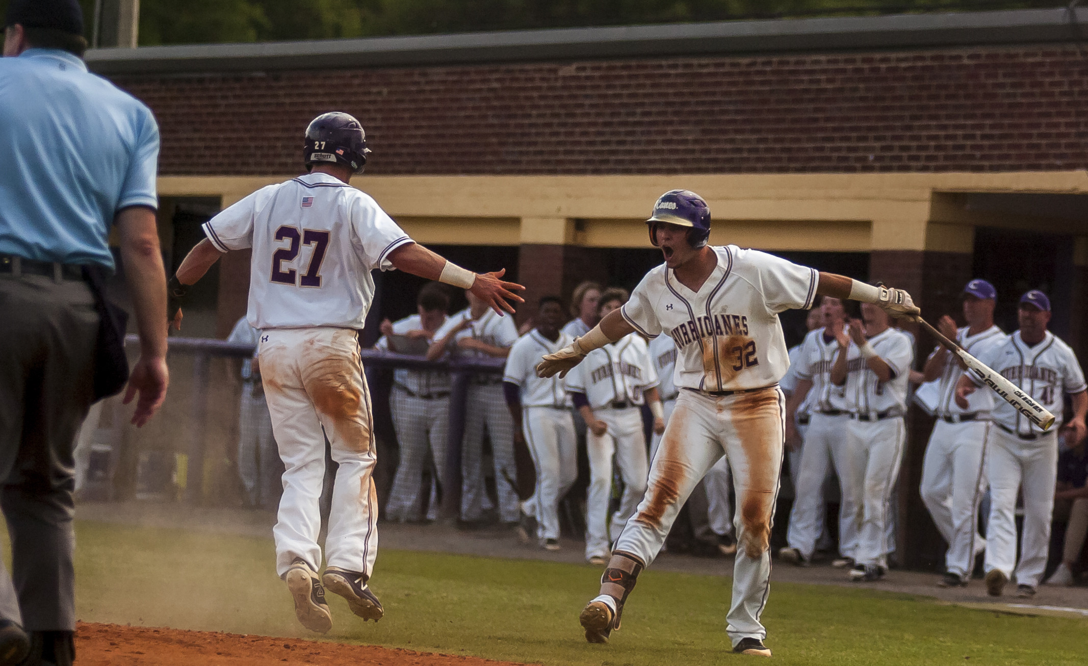 Preston Welchel (27) and Devin Warner celebrate Welchel's run in the sixth inning of Game 1