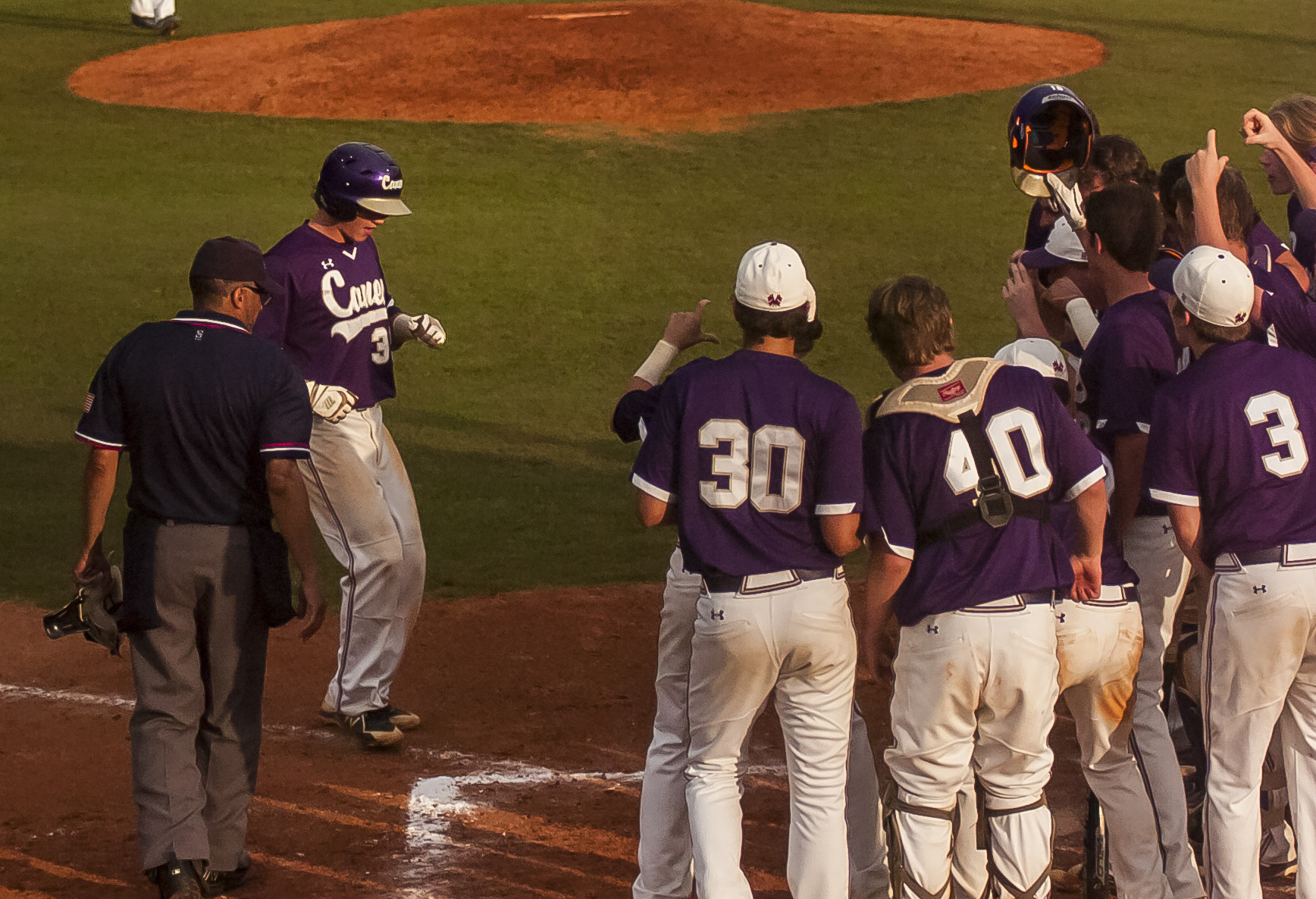Josh Davis celebrates with his teammates after his game-tying home run.