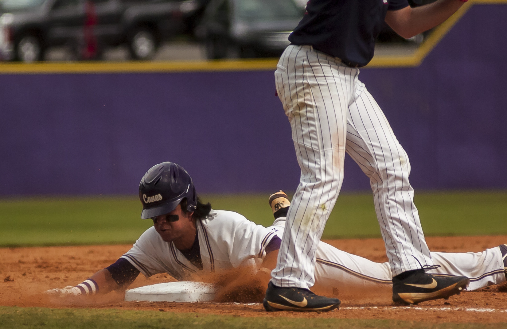 Anthony Seigler slides safely into third base.