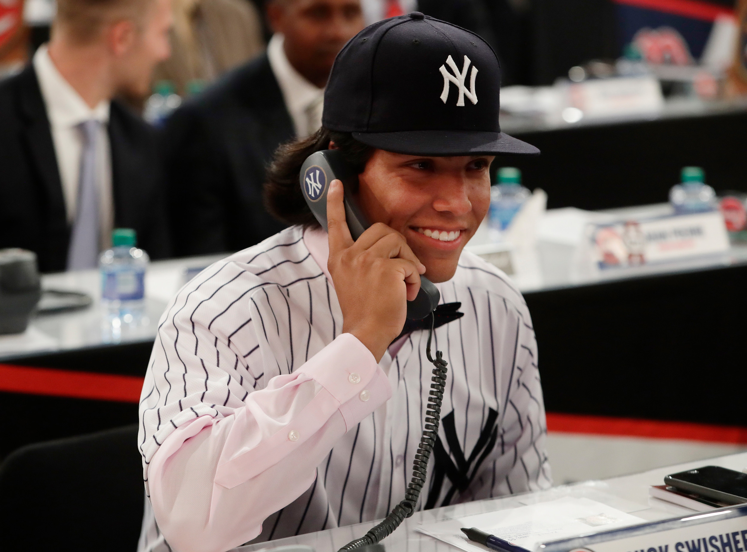 Cartersville's Anthony Seigler speaks on the phone with a member of the New York Yankees after being selected 23rd by the Yankees during the first round of the Major League Baseball draft Monday in Secaucus, New Jersey.