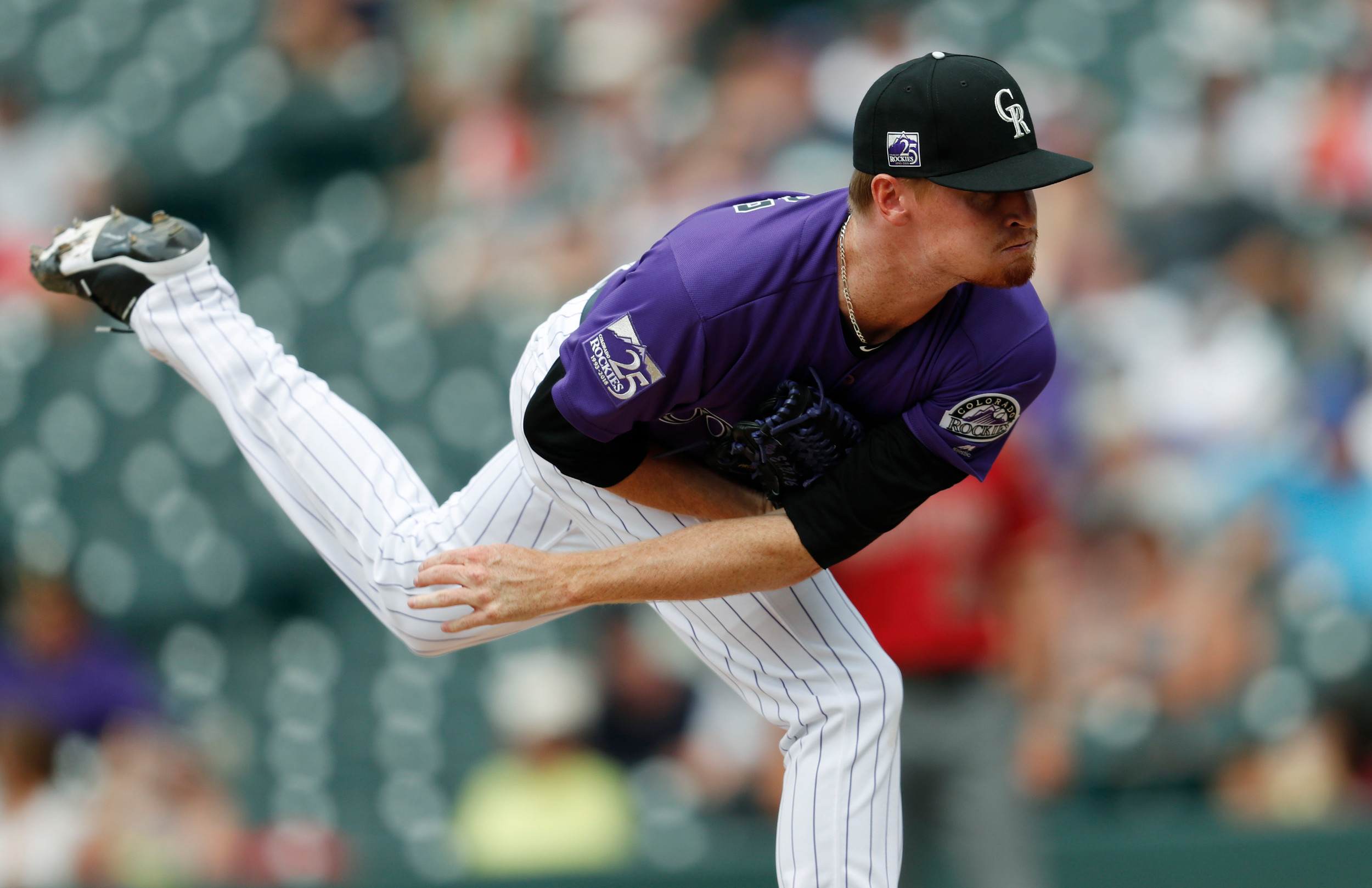 Colorado Rockies relief pitcher Sam Howard delivers a pitch to Arizona Diamondbacks' Ketel Marte in the ninth inning of a baseball game Sunday in Denver. The scoreless outing marked the MLB debut for Howard, who graduated from Cartersville High in 2011.