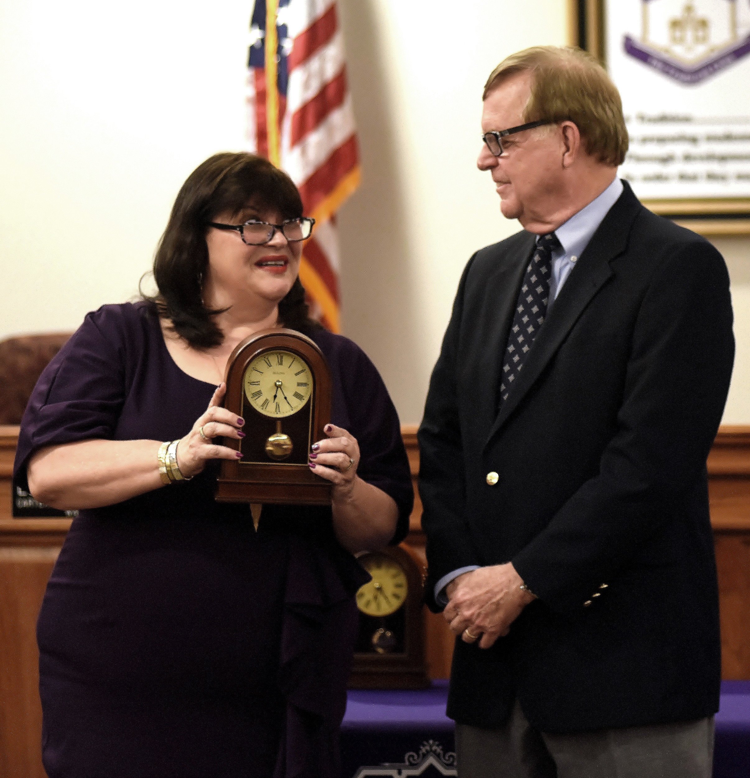 Cartersville City School Board President Kelley Dial presents retiring superintendent Dr. Howard Hinesley with a retirement clock at his final Cartersville City School Board meeting Monday night.