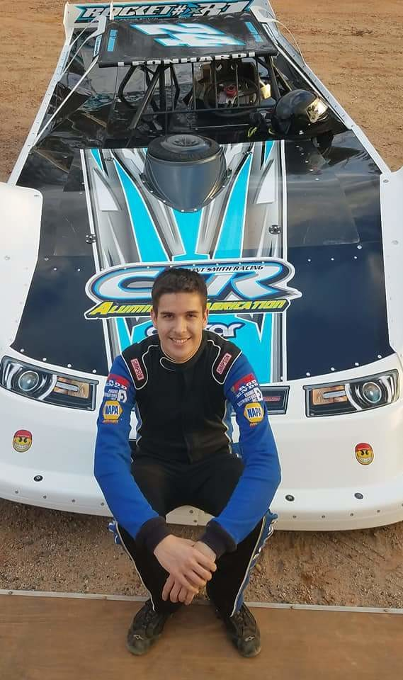 Zach Leonhardi sits on the hood of his super late model race car. The 17-year-old Woodland High student earned his first victory in the division earlier this month, taking the checkered flag in a June 9 race at Senoia Raceway.