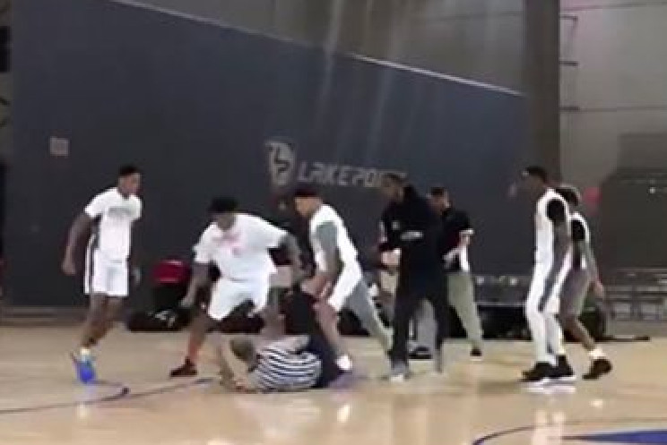 In this screenshot of a video posted to Twitter, players on the Chicago-based R.A.W. Athletics fight an official during a tournament game at LakePoint's Champions Center on Sunday.