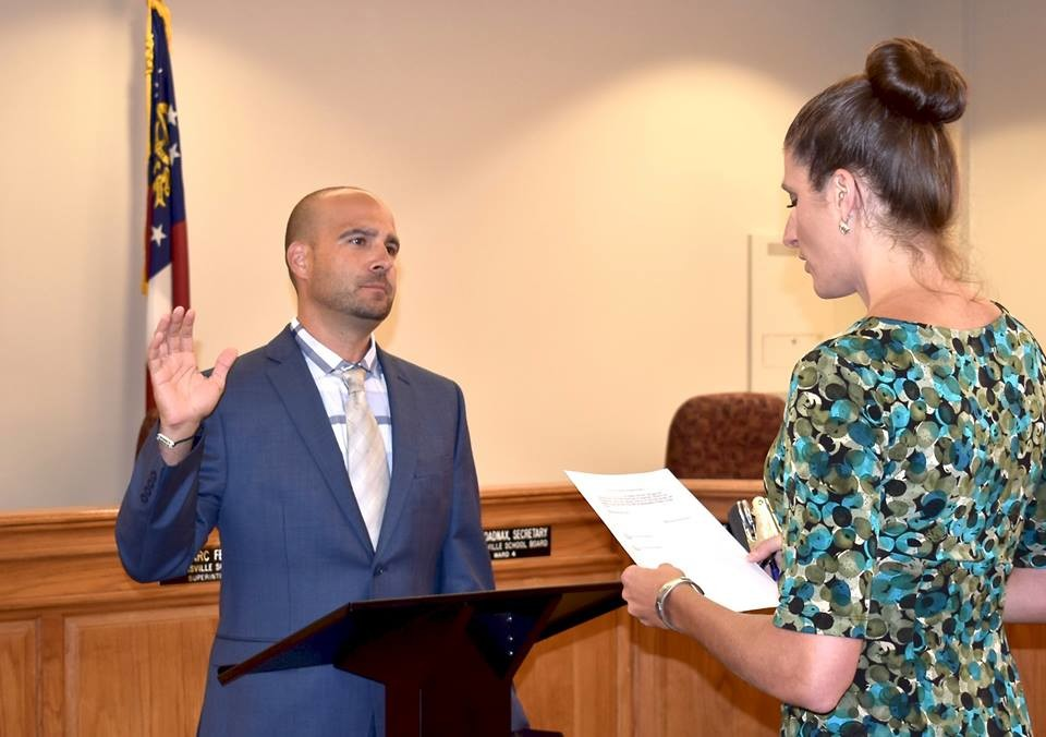 Cartersville City Clerk Meredith Ulmer administers the oath of office to new Cartersville City School Superintendent Dr. Marc Feuerbach before Monday night's school board meeting.