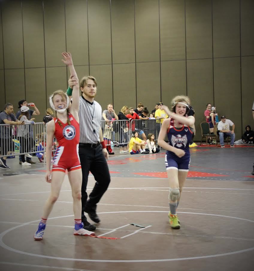 Kailey Rees, left, is awarded the victory in a third-place match at a national event.