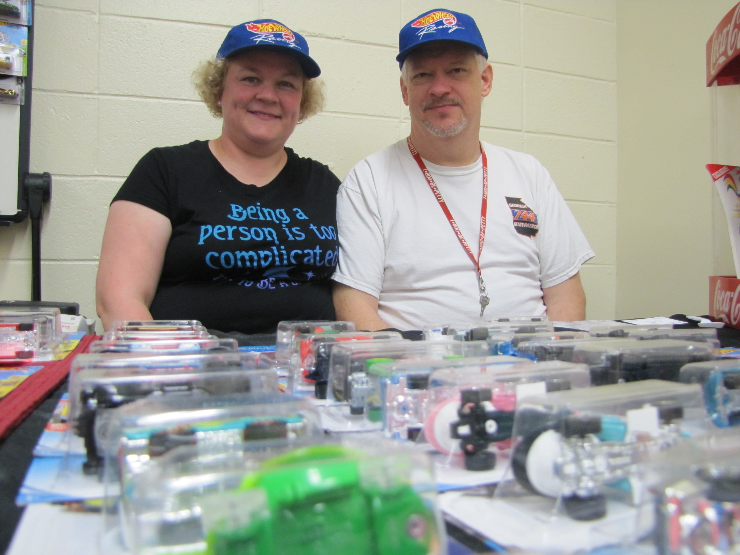 Marcia Hall and Russ Kelly, Jr., show off their lineup of Hot Wheels merchandise.