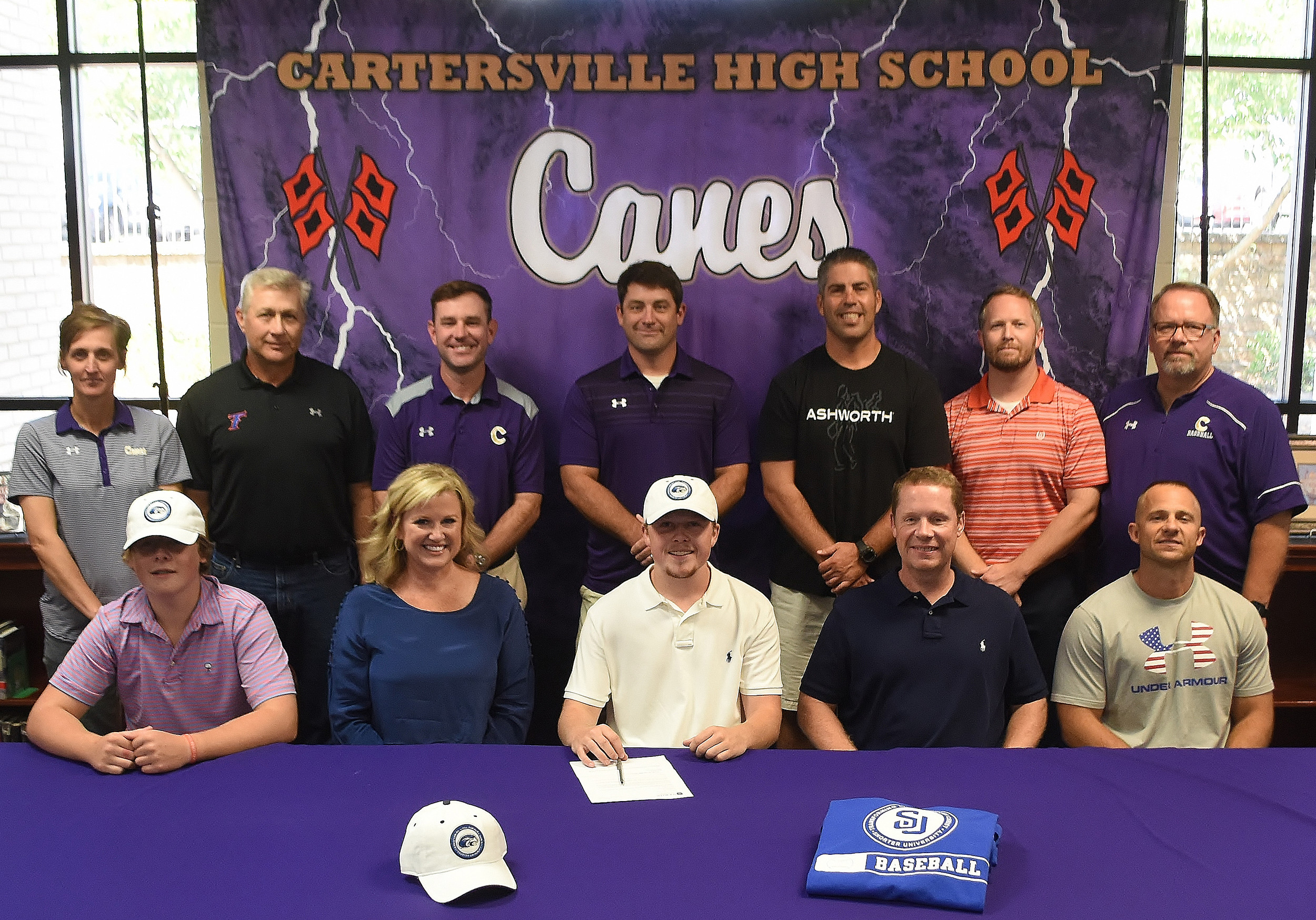 Cartersville High School 2018 graduate John Reed Evans, front row, center, signed on Tuesday to play baseball at Shorter University in Rome. On hand for the signing were, front row, from left, Brady Evans, brother; Dede Evans, mother; Tony Evans, father; and Corey Gochee, CHS assistant baseball coach; back row, from left, Shelley Tierce, CHS principal; Byron Kizer, Evans' summer ball coach; Kyle Tucker, CHS head baseball coach; Brandon Patch, CHS assistant baseball coach; David Cagle, CHS assistant baseball coach; Drew Startup, Evans' youth pastor; and Darrell Demastus, CHS athletic director.