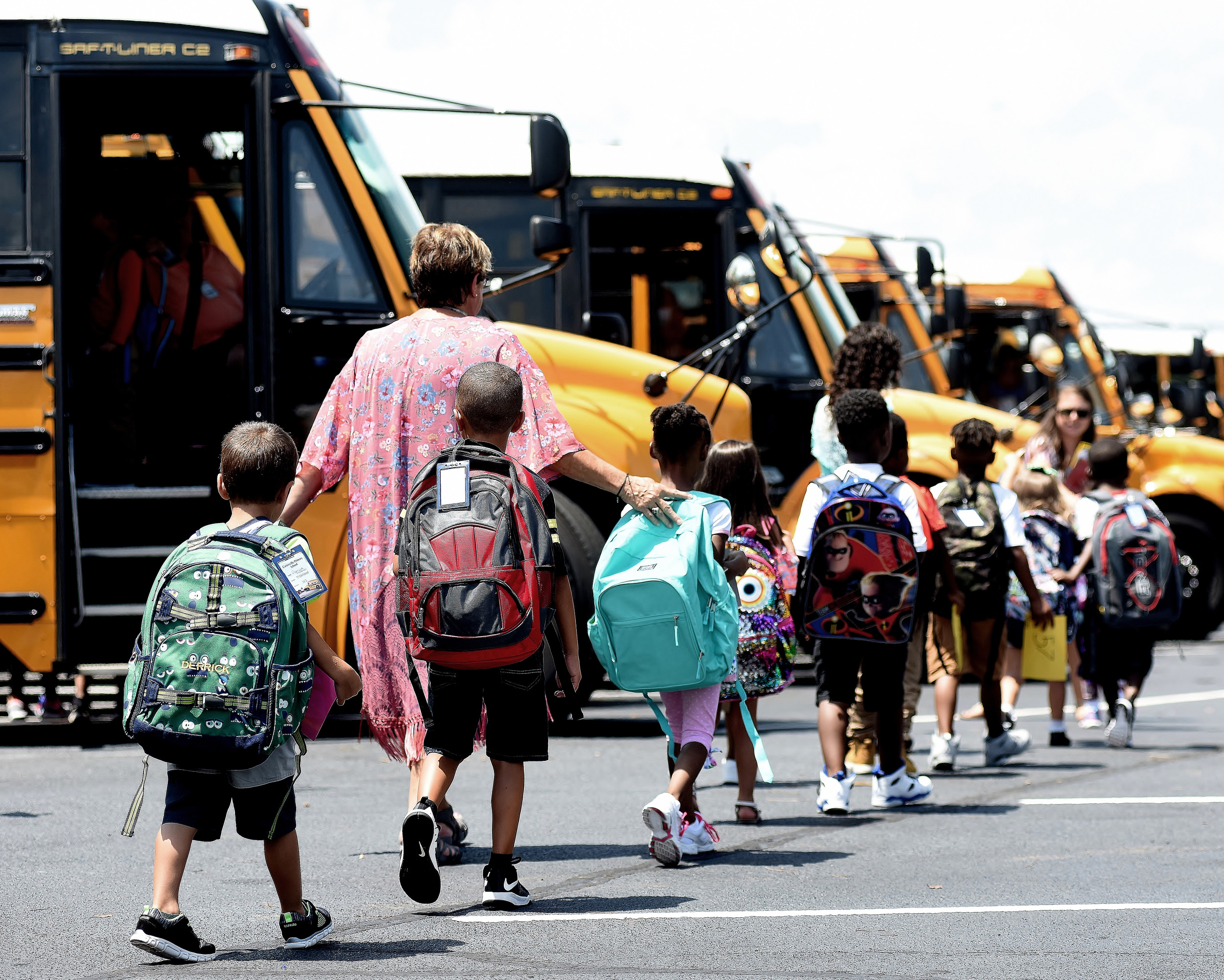 Students at Cartersville Primary School walk to their bus Wednesday after their first day of the 2018-2019 school year.