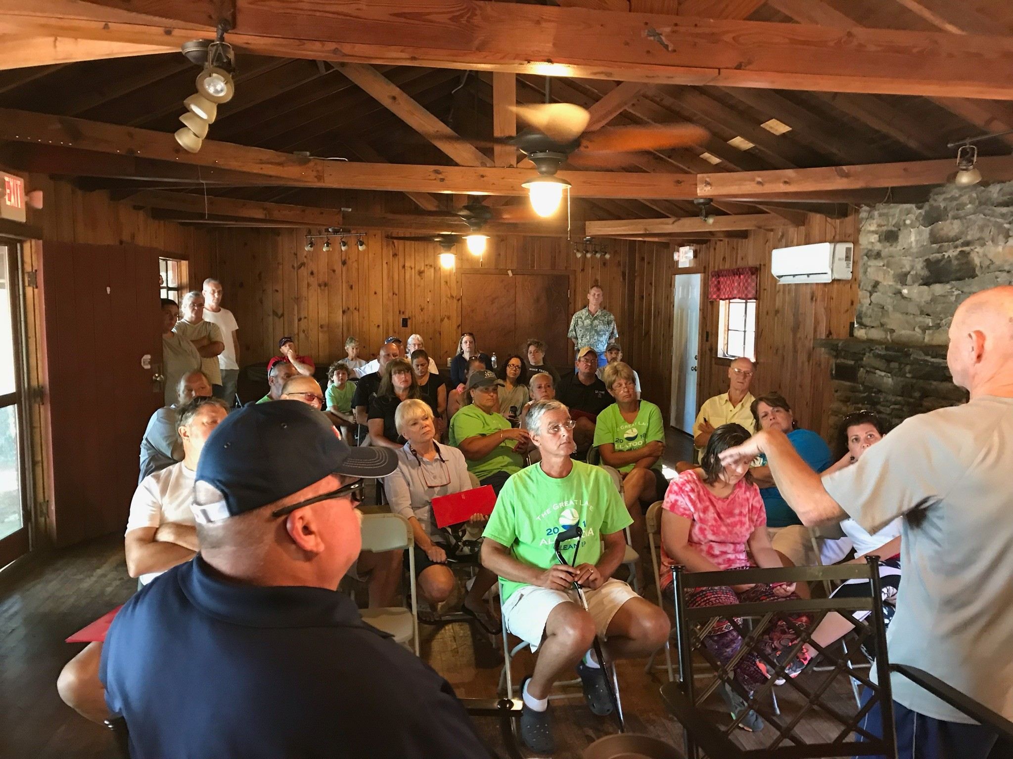 Adopt-a-Mile volunteers attend a meeting at Glade Marina July 28.