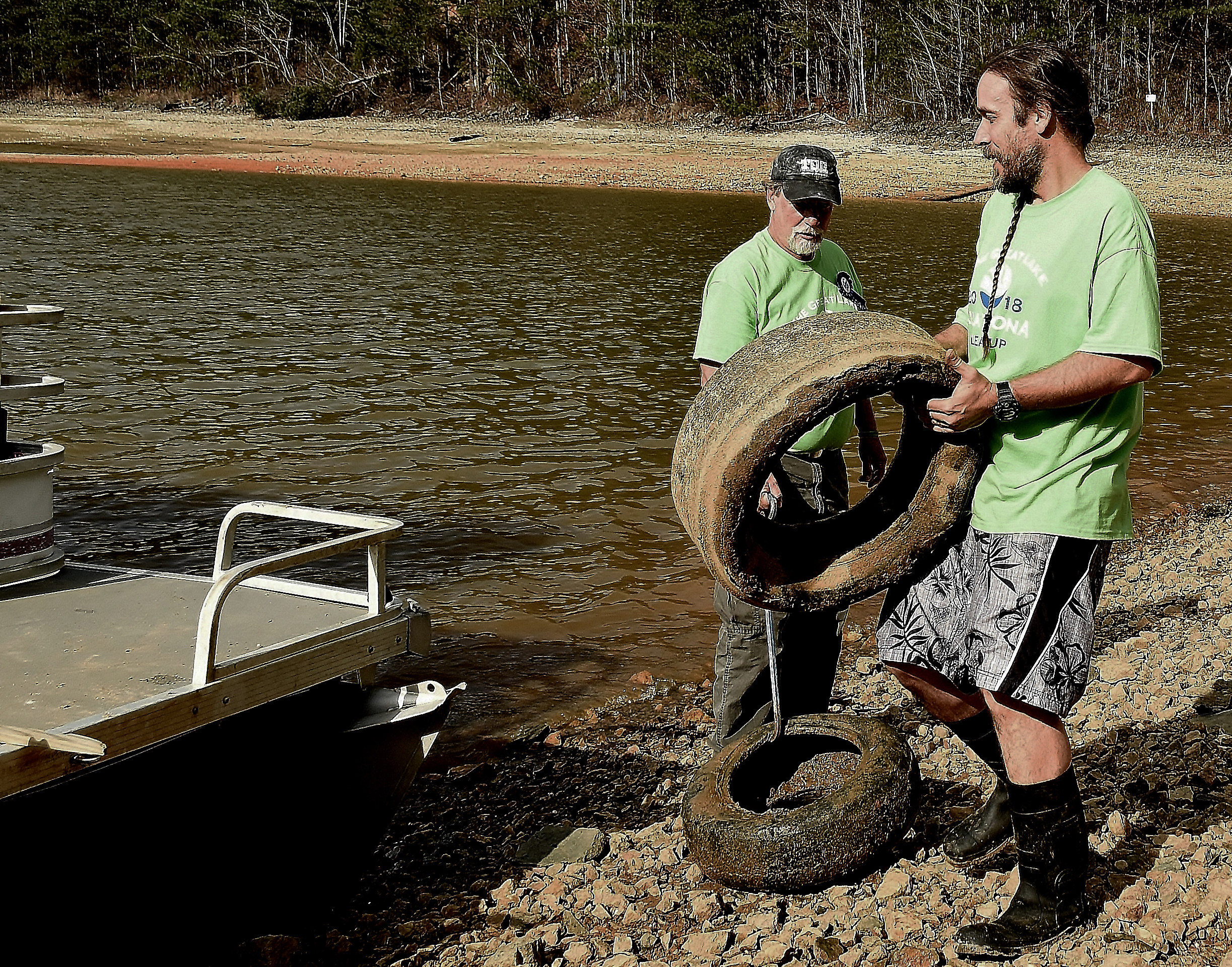 Dave Matthews, right, and Randy West with the Lake Warriors program clean the shore of Lake Allatoona in late February.