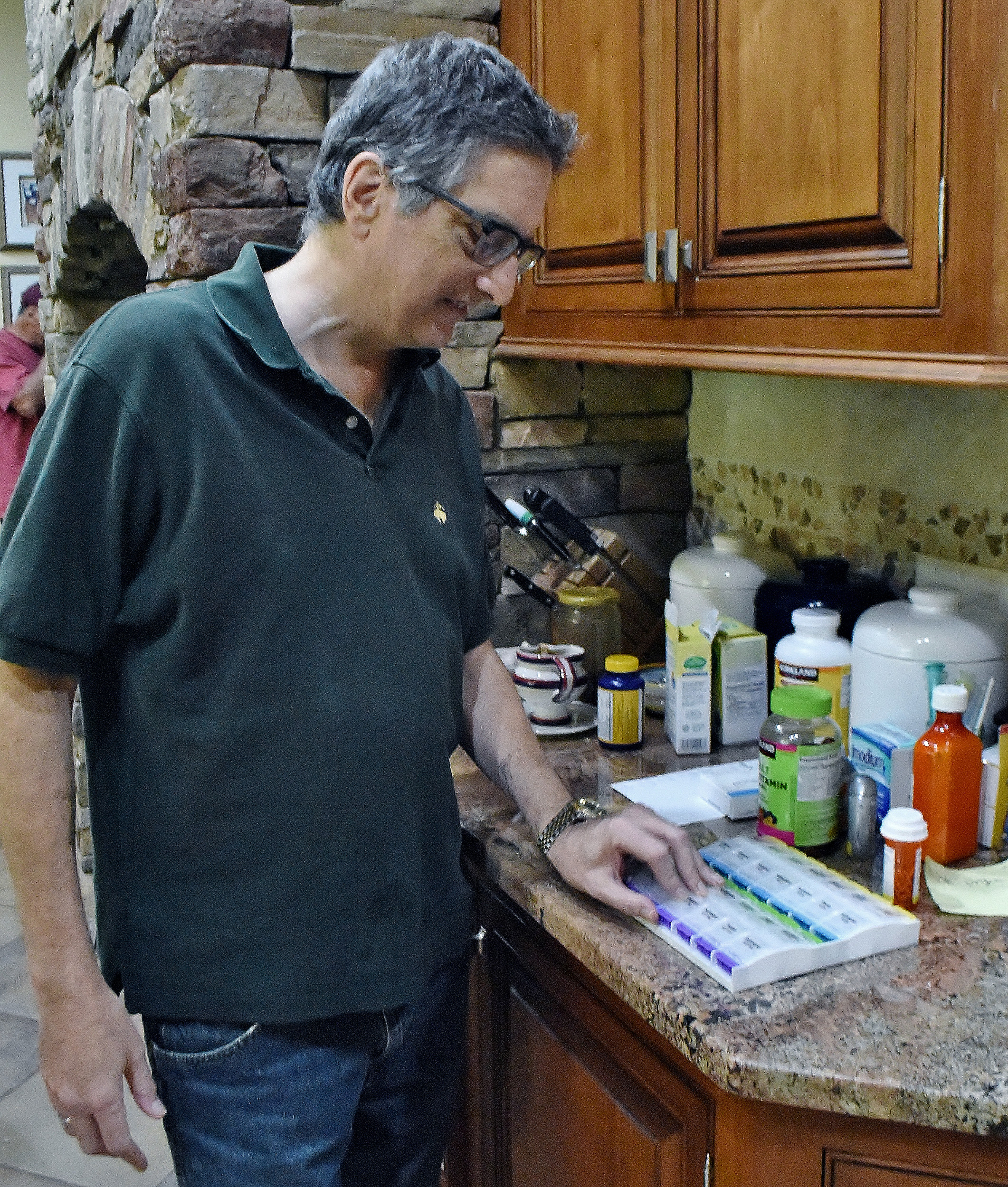 Since receiving his kidney, 58-year-old Stuart Miller is on a strict regimen of medications.