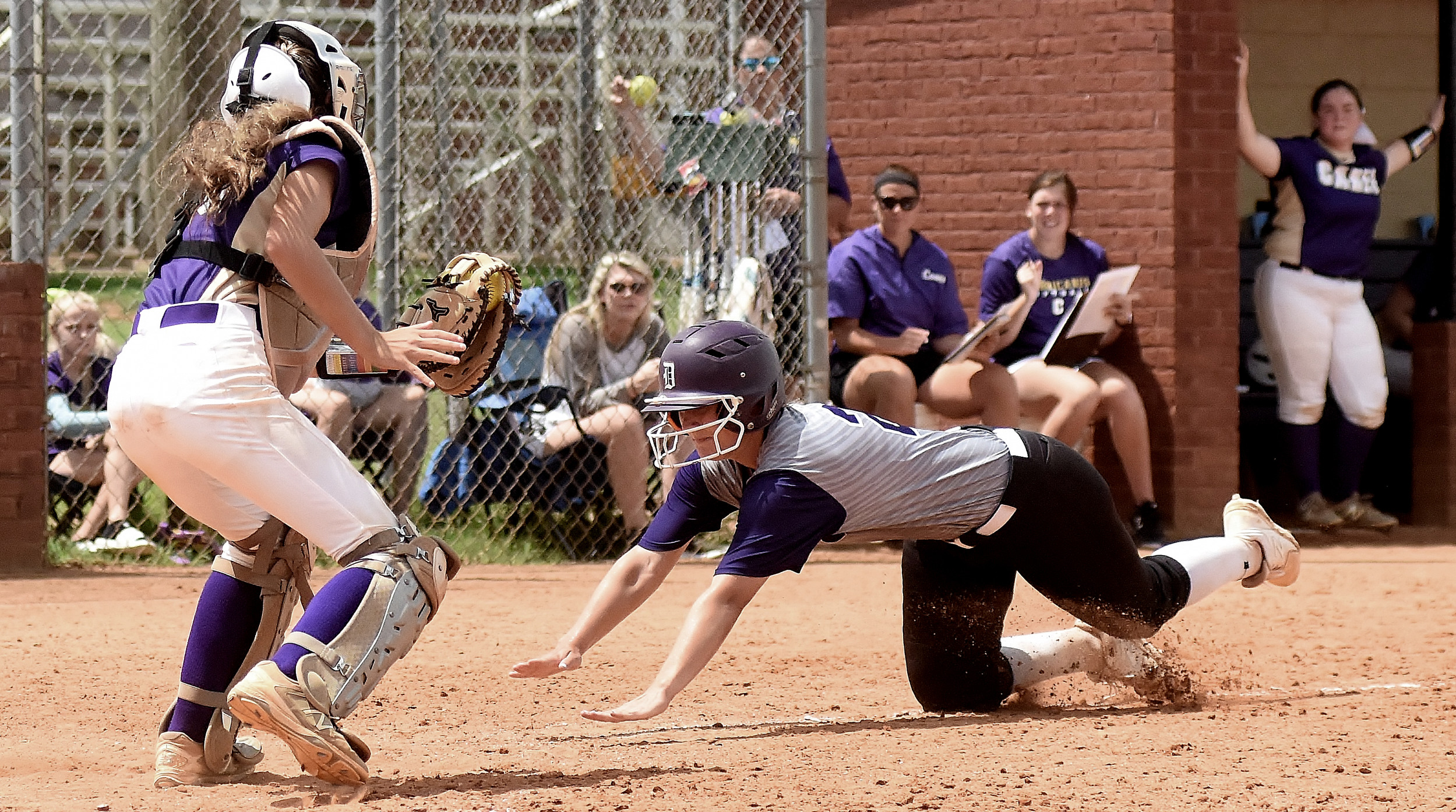 Cartersville catcher Lauren McElhaney prepares to tag a Darlington runner out at the plate for the final out of the Canes' 7-5 victory Saturday.