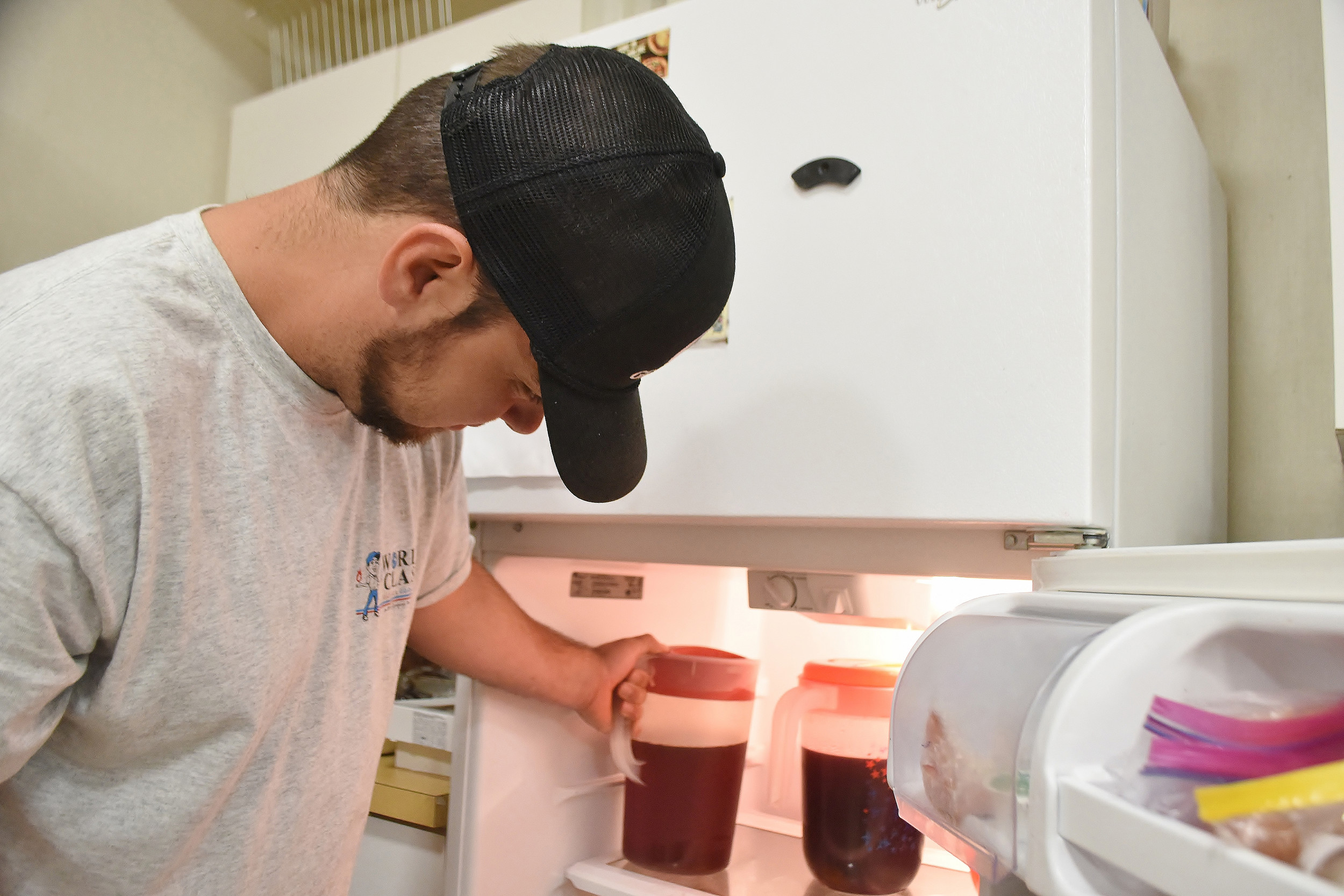 "Dakota, a guest at the Good Neighbor Homeless Shelter in Cartersville, reaches into the facility's refrigerator for a pitcher of tea. The nonprofit is participating in the State Farm Neighborhood Assist contest, in which the Top 40 ""causes"" will each be awarded $25,000. If chosen as a winner, the Good Neighbor will use part of its winnings to replace appliances in the shelter's kitchen."