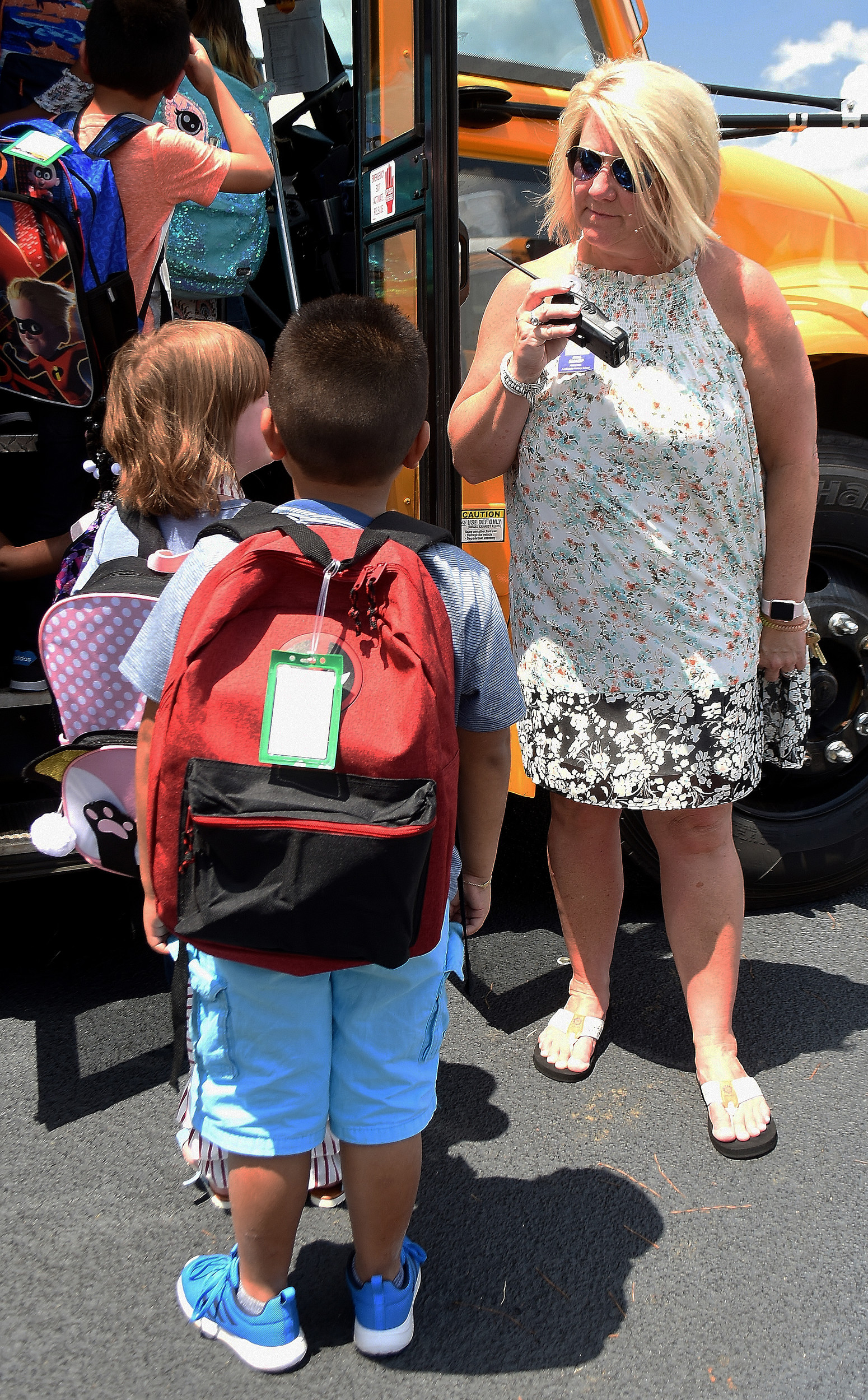 RANDY PARKER/THE DAILY TRIBUNE NEWS Cartersville Primary School Principal Gina Bishop watches as students board their bus after the first day of school Aug. 8.
