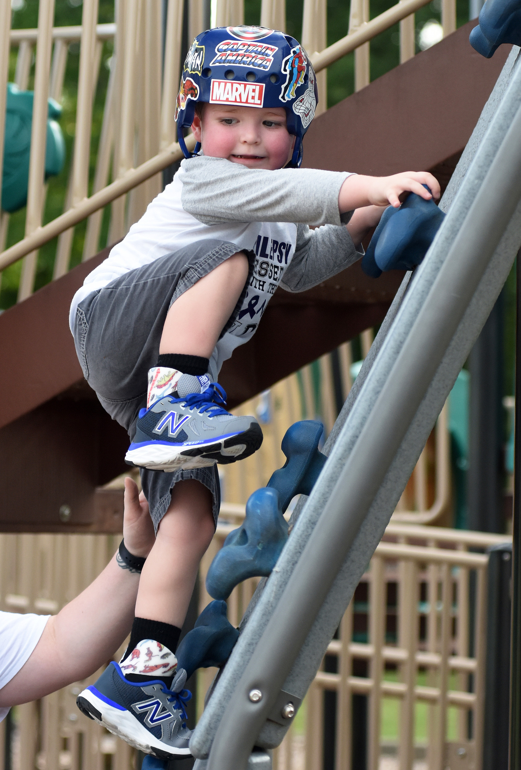 Three-year-old Cade Allen climbs on one of the Dellinger Park playgrounds.