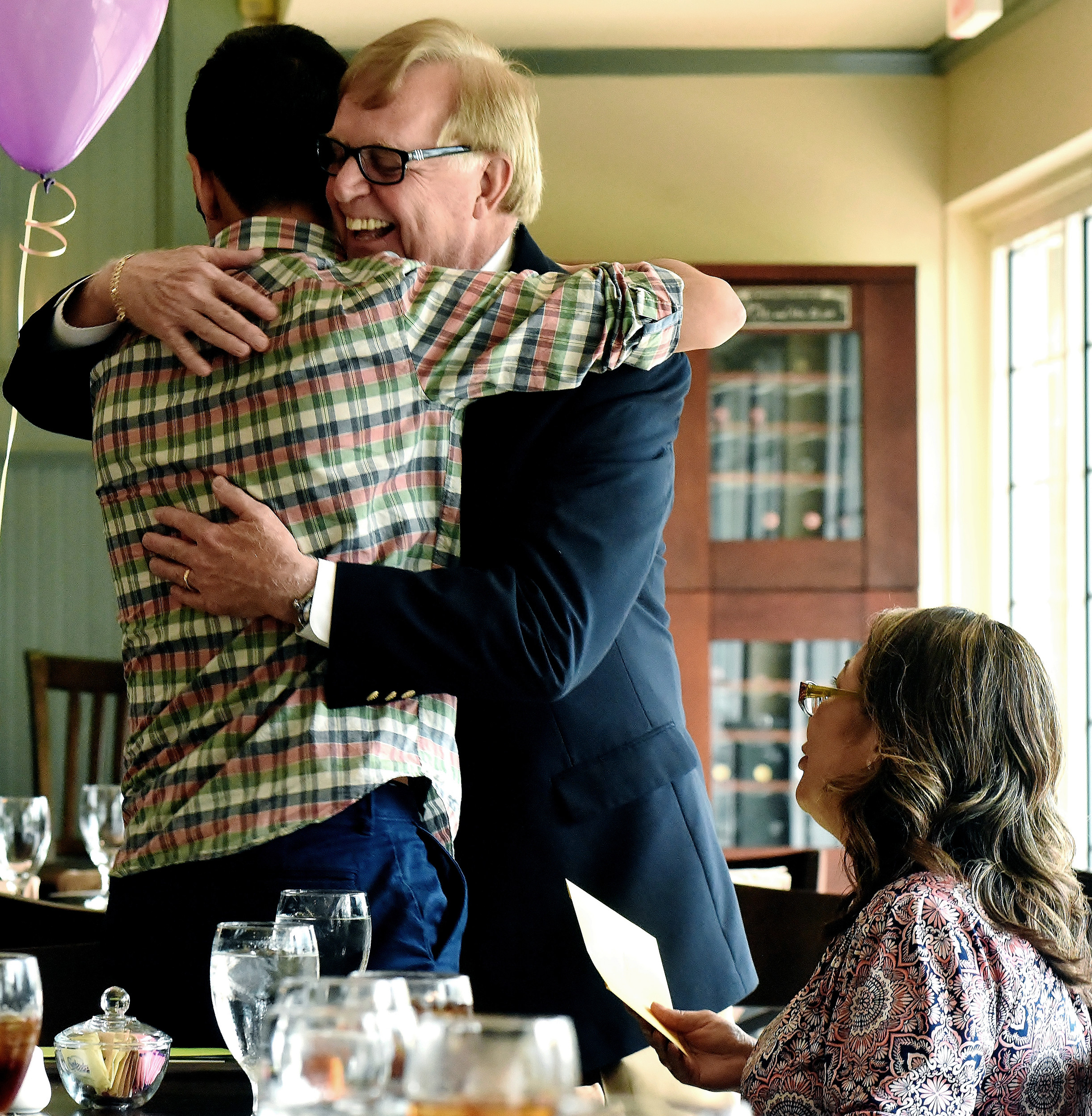 Retired Cartersville School Superintendent Dr. Howard Hinesley gives GateKey Scholar Abel Espinoza a hug after congratulating him on being the first recipient of the Howard Hinesley Founder's Scholarship. Abel's mother, Esther Espinoza, looks on.