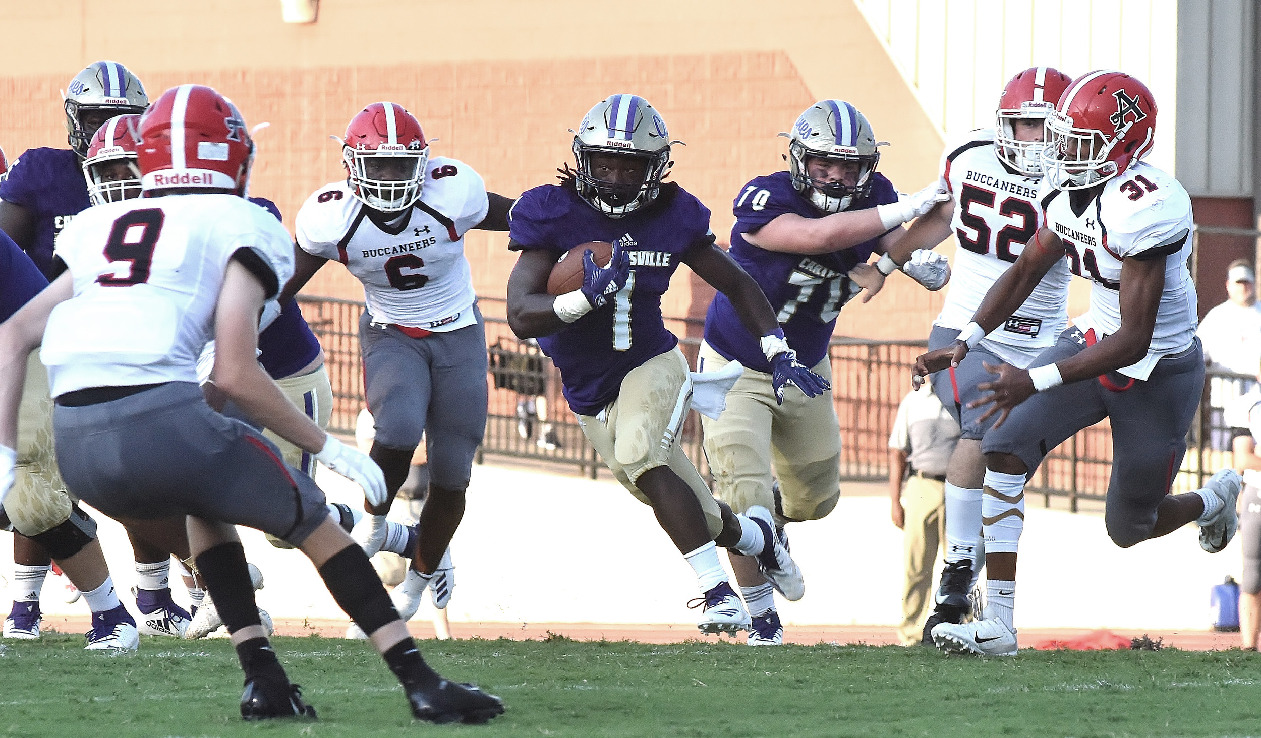 Cartersville's Marcus Gary cuts through the Allatoona defense during Friday's game at Weinman Stadium. Gary finished with 19 carries for 144 yards and one touchdown, and he added three receptions for 94 yards and a touchdown.