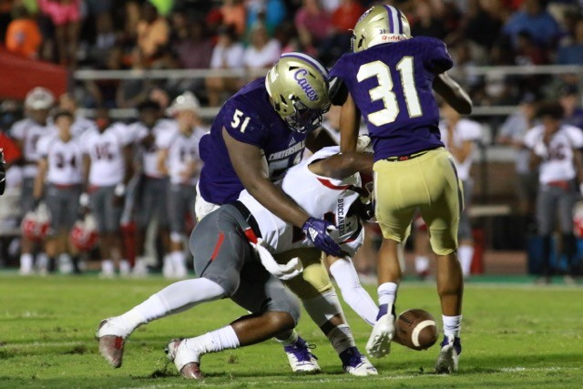 La'Kwayme Jupiter (51) rips down an Allatoona ballcarrier as Amari Orr (31) gets in on the play during Friday night's game against Allatoona at Weinman Stadium.