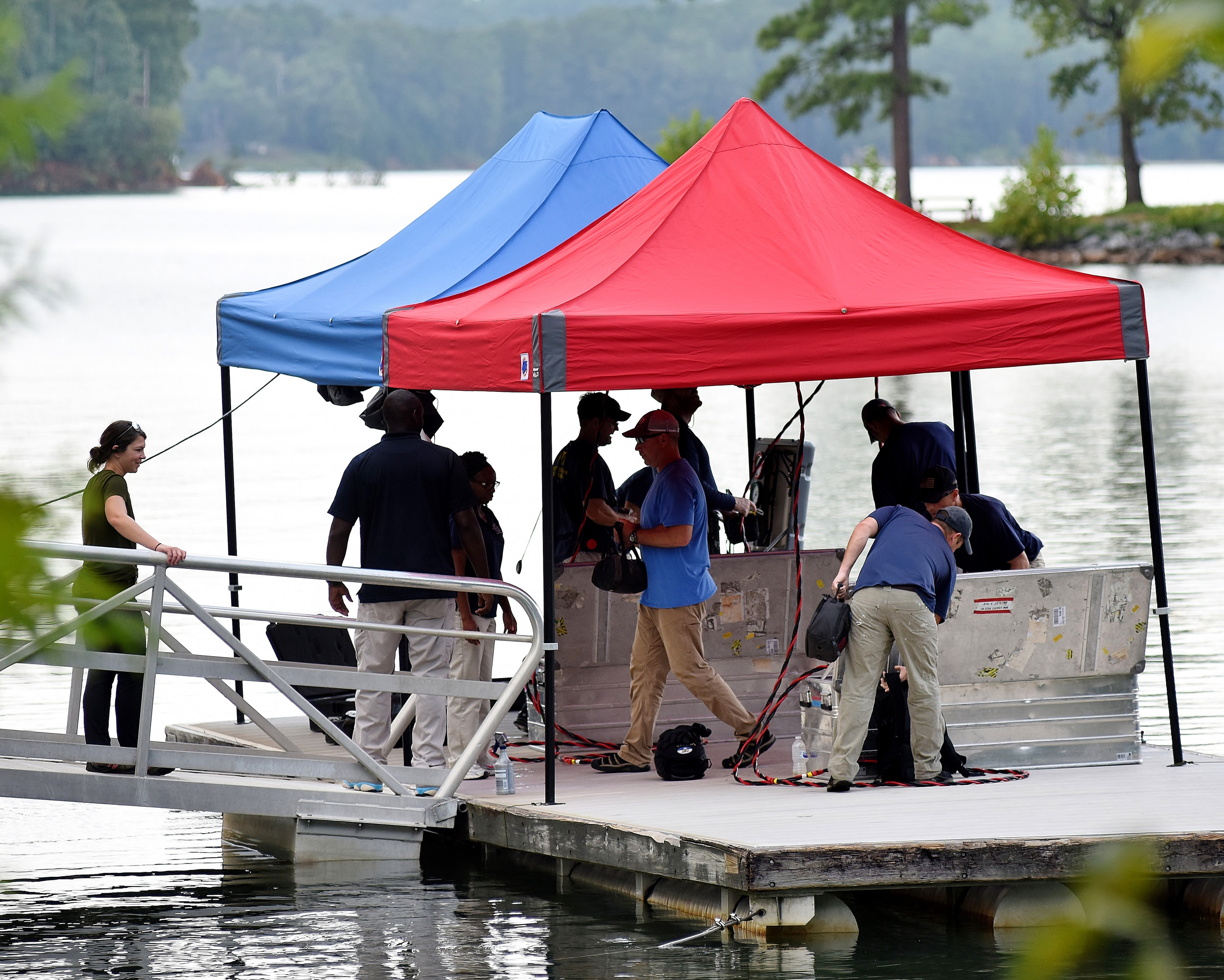 "Bartow County Sheriff's Office personnel work to gather evidence Monday afternoon at the Red Top Mountain State Park boat landing. BCSO spokesman Jonathan Rogers said investigators were ""attempting to recover evidence on a several-years-old case."" Rogers added ""new information was received,"" but could not release more details, saying the release of ""information we are receiving could jeopardize the investigation."""