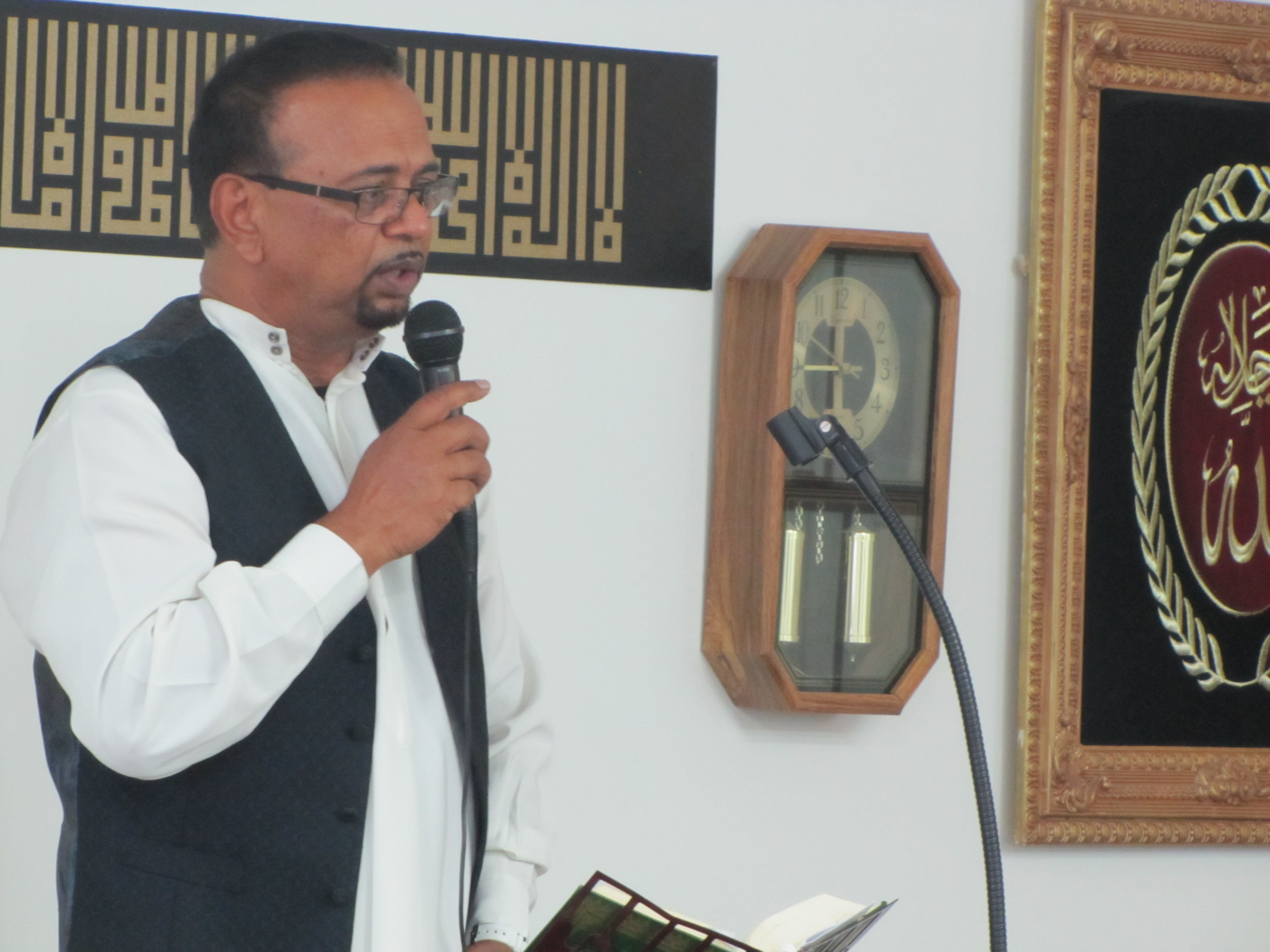 Community leader Nassim Baksh gives a sermon at the Masjid Quba Islamic Center of Cartersville Tuesday morning to commemorate Eid al-Adha.