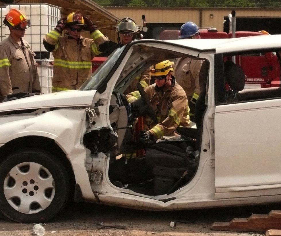 Firefighter candidates learn how to use a jaws of life to tear apart a car in order to extract a trapped person.
