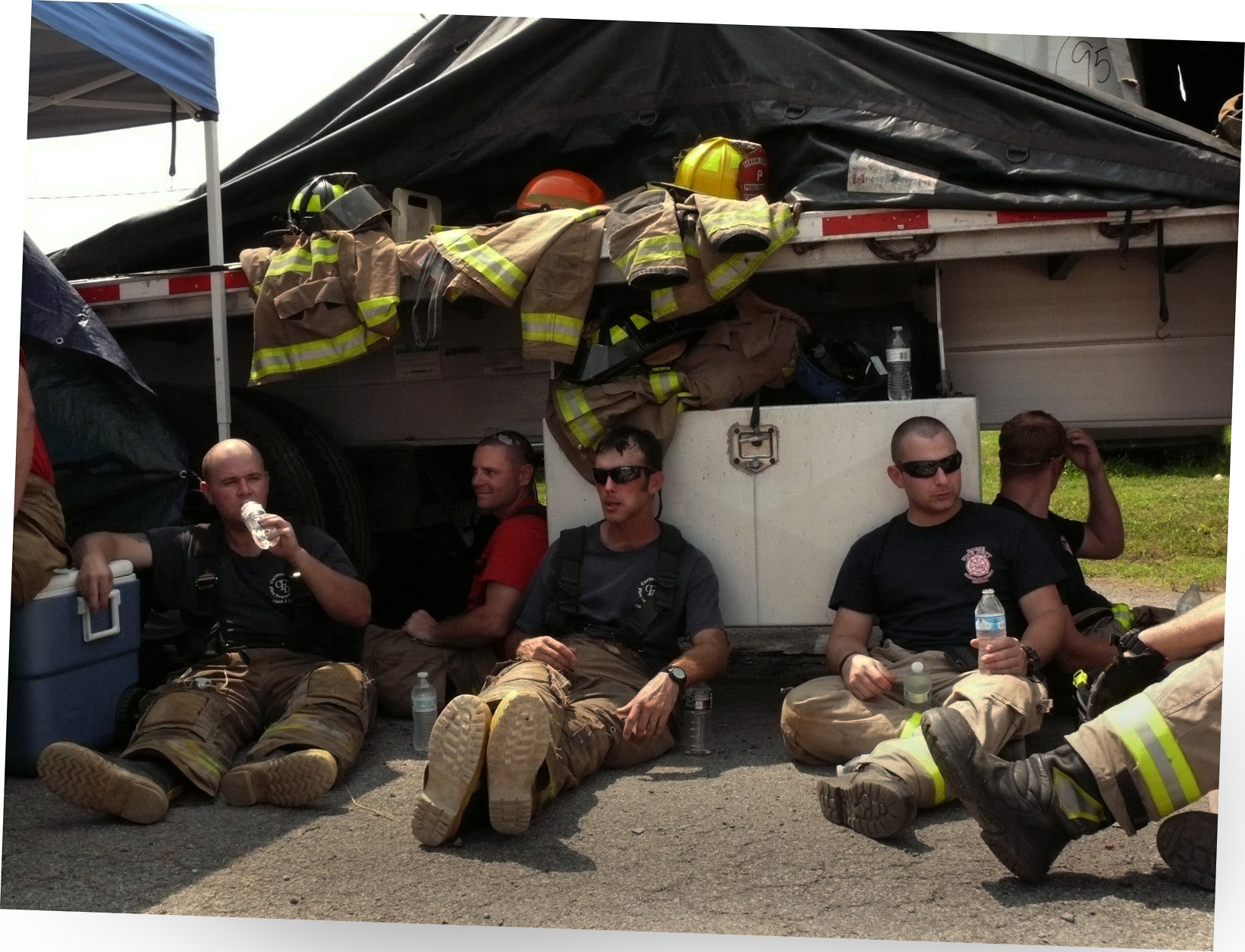 Firefighter candidates take a welcome breather from Rookie School.