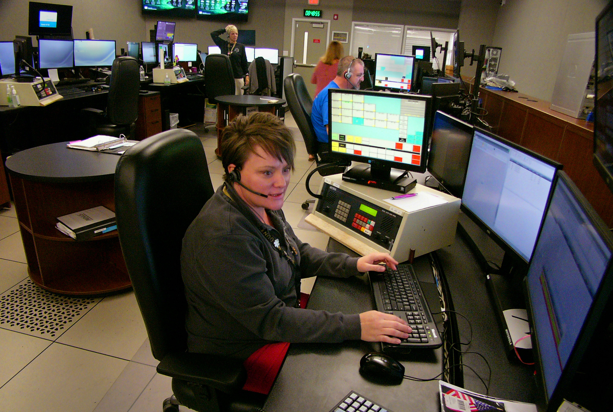 Shannon Silvers takes an emergency call at Bartow County's 911 Call Center. The center will soon  be under the auspices of the Georgia Emergency Communications Authority.