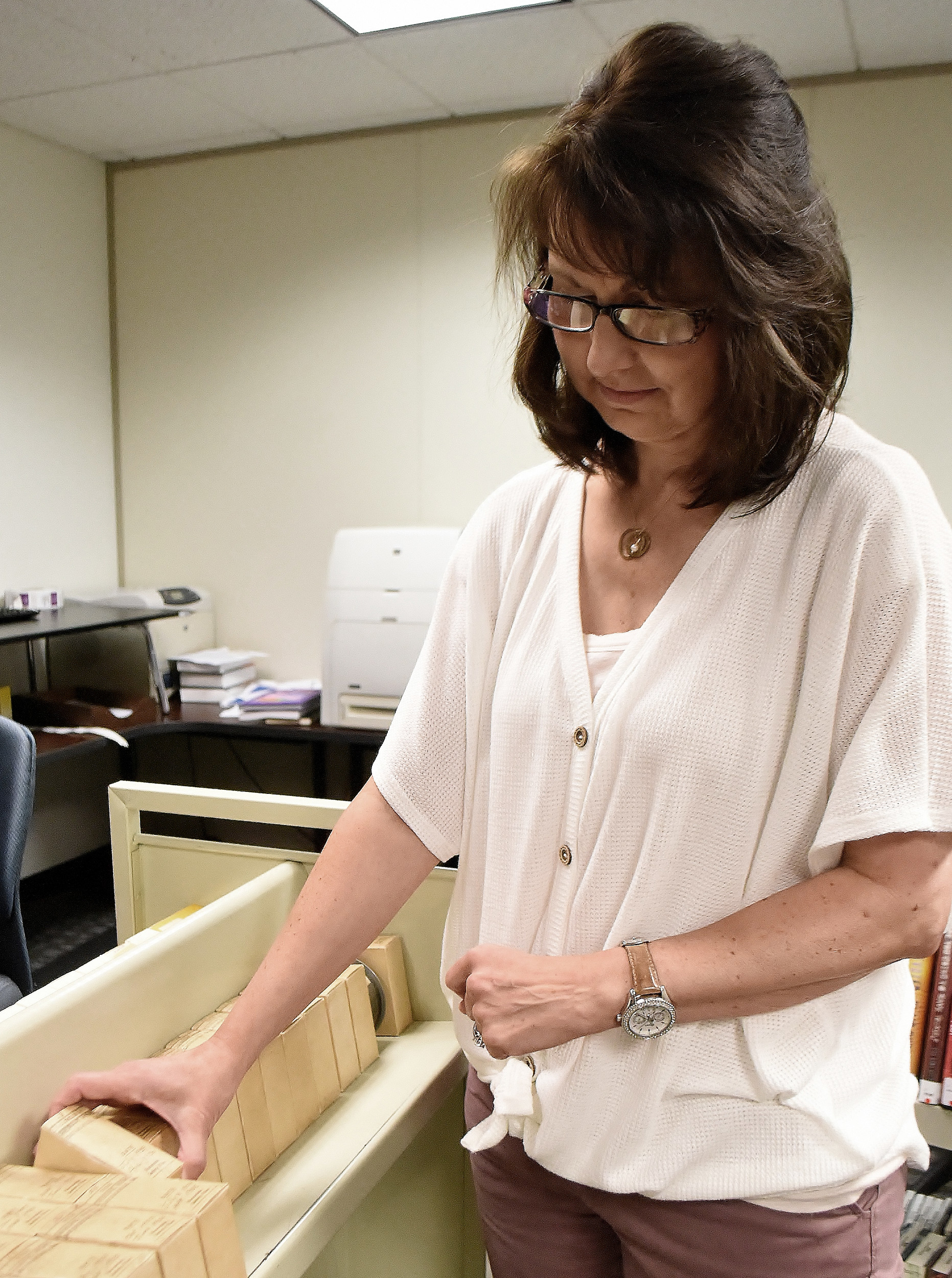 Jill McAllister, director of finance and outreach for the library, sorts through boxes of microfilm that The Daily Tribune News turned over to the Cartersville Public Library last week.