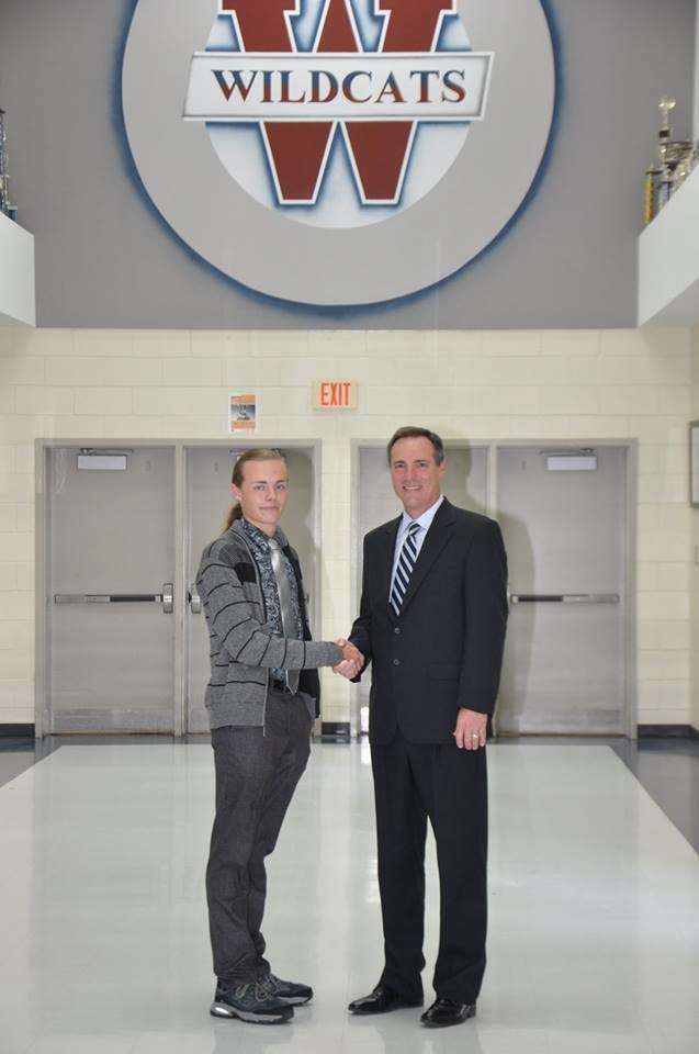 Superintendent Dr. Phillip Page, right, congratulates Woodland High senior Ezra Petron for winning a 2018 AP Scholar Award.