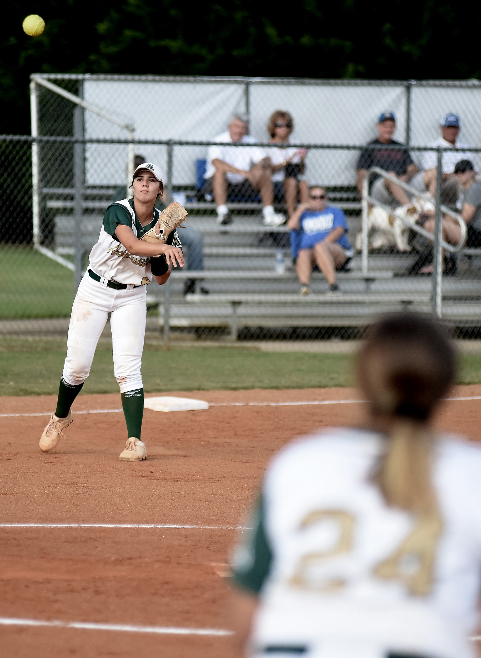 Adairsville's Sadye Johnson throws across the diamond from third base to get a Ringgold runner at first.